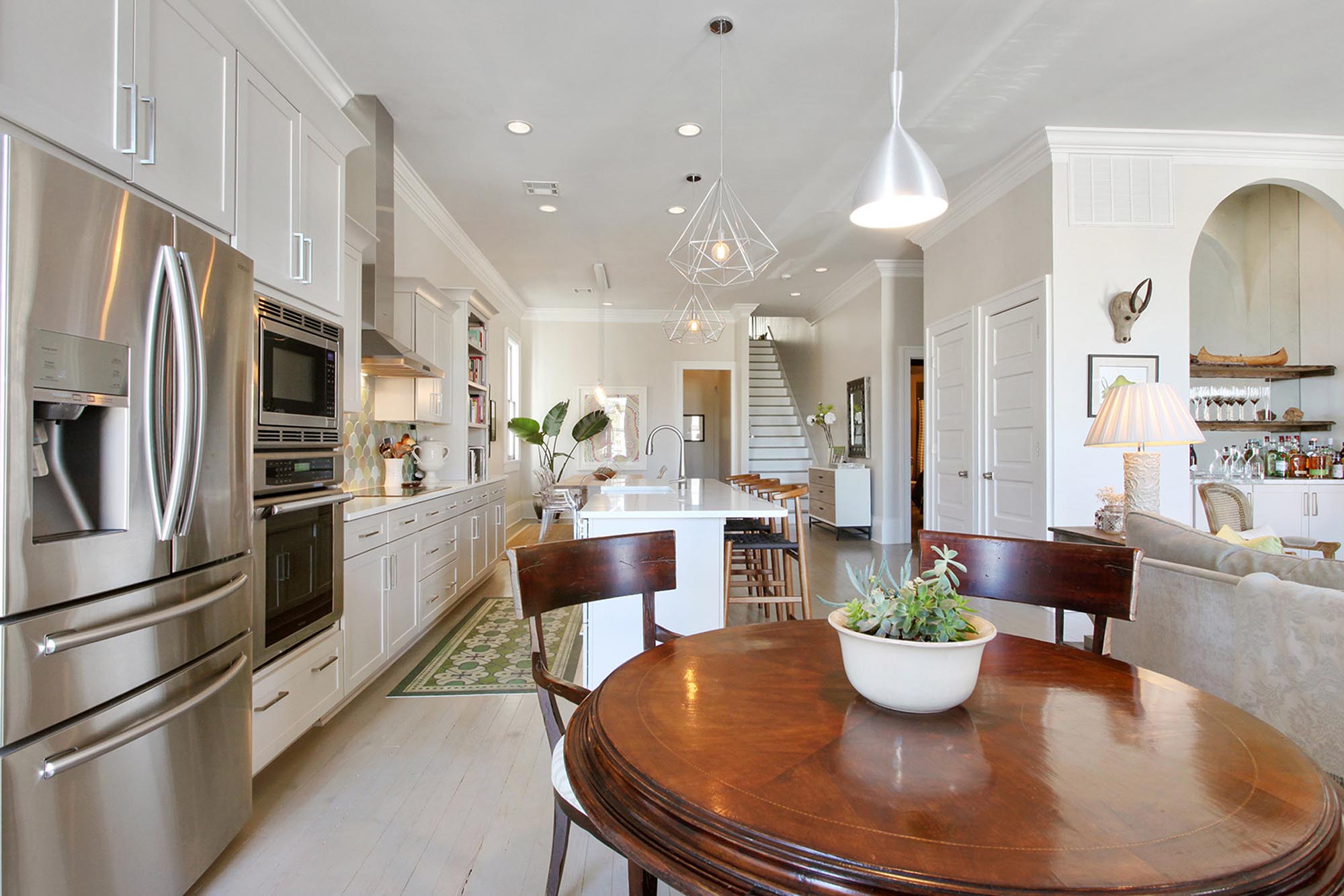 Breakfast nook and kitchen areas with modern appliances