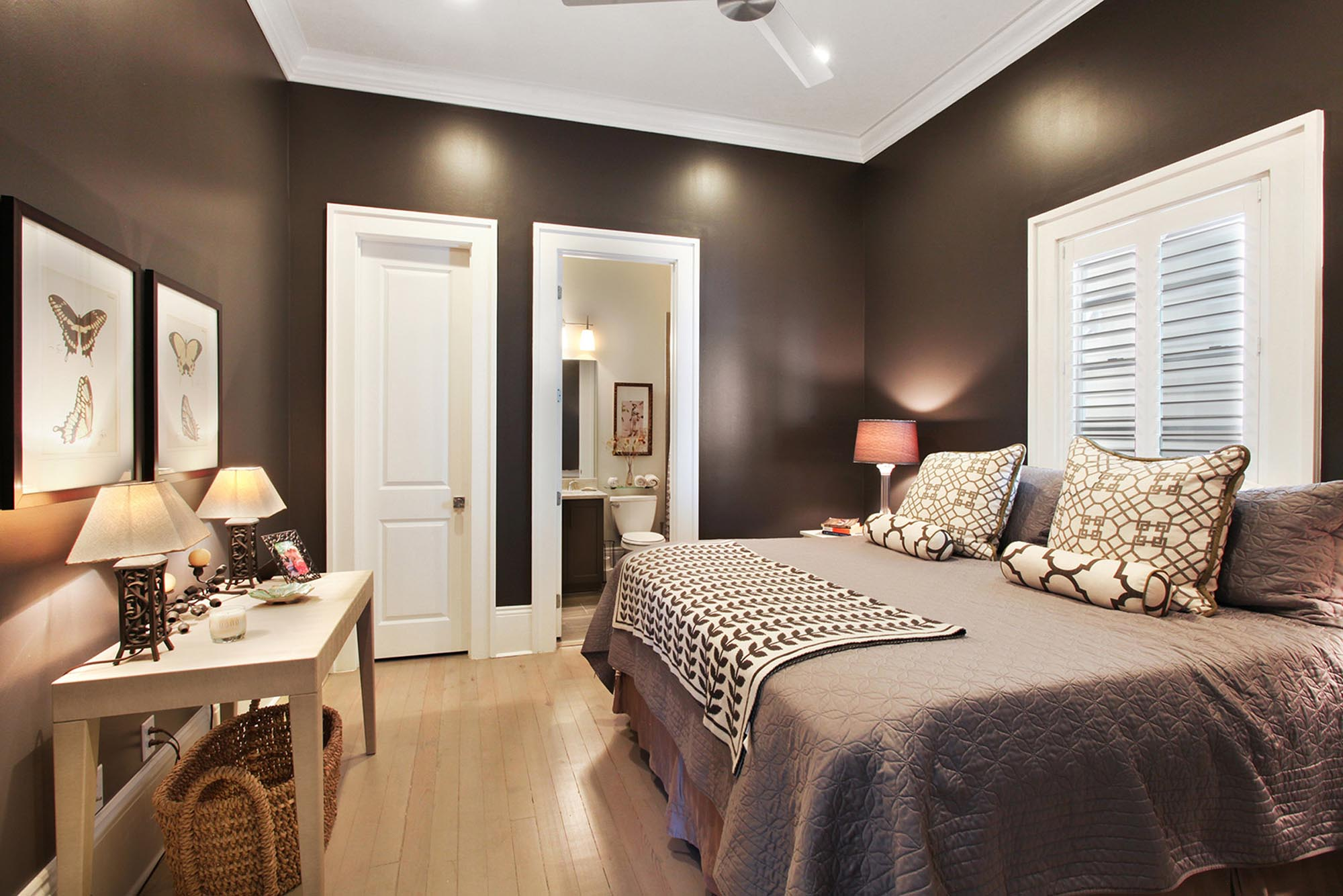 Dark gray bedroom with king sized bed and bedside lamps