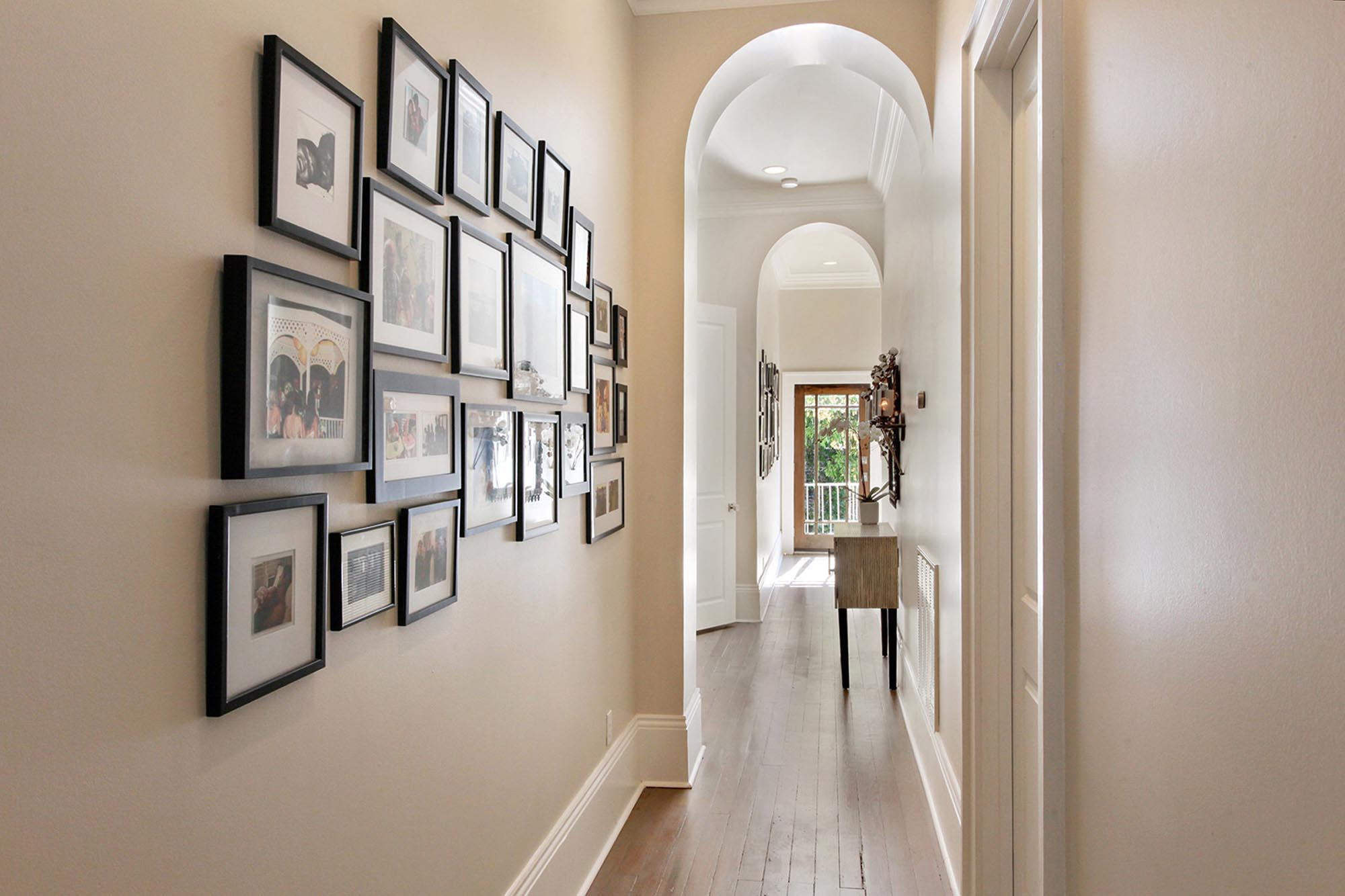 Hallway with frames hanging on wall