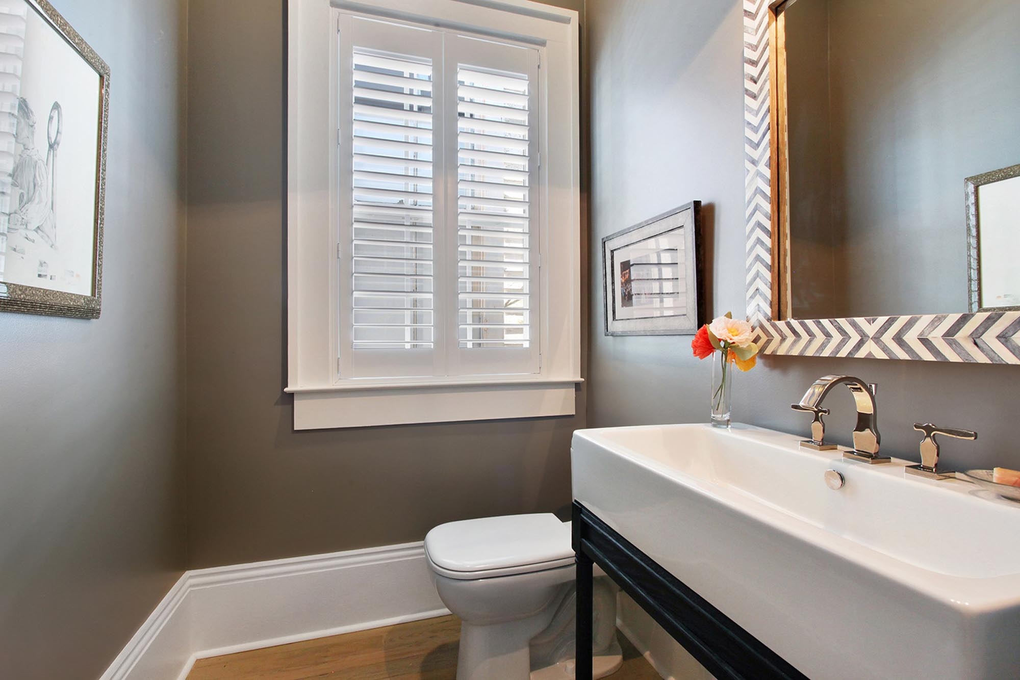Stylish bathroom with decorative framed mirror over a long sink