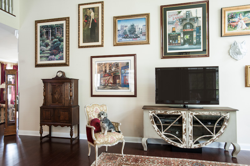 Our clients' extensive art collection and treasured antiques mixed with a new distressed media cabinet and Sophie the family dog. What's not to love?!