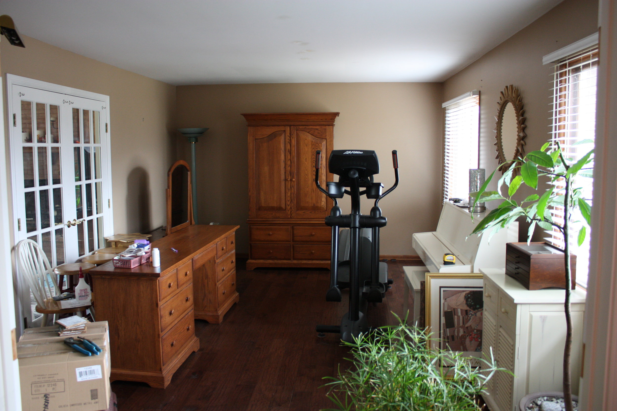 Before  - The formal living room served as a combination storage space and exercise room.