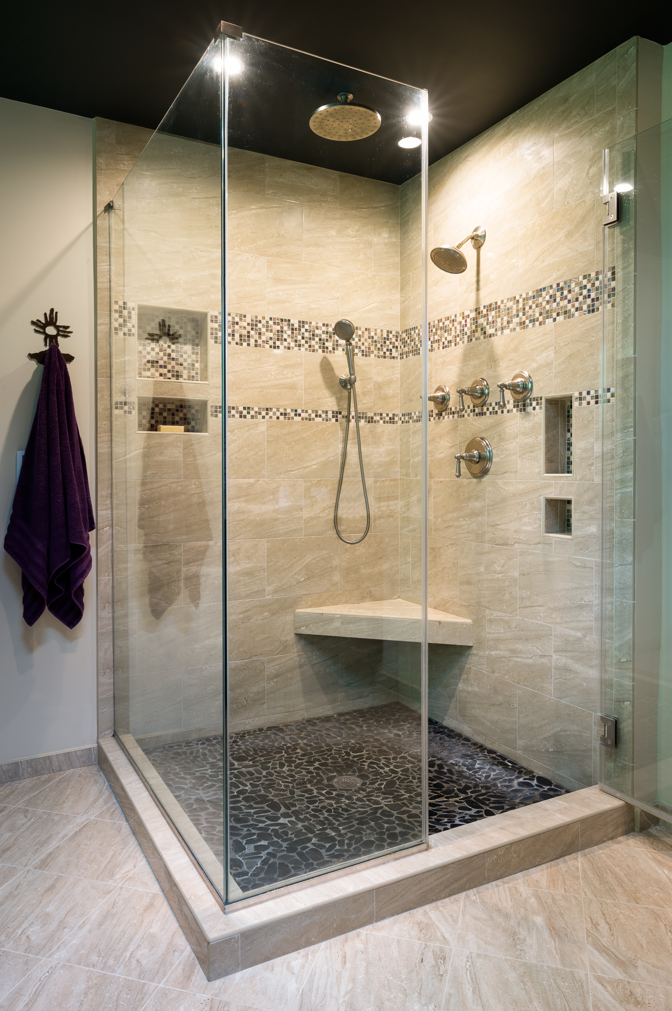 After  - A separate rain shower and hand-held shower provide maximum enjoyment and functionality.