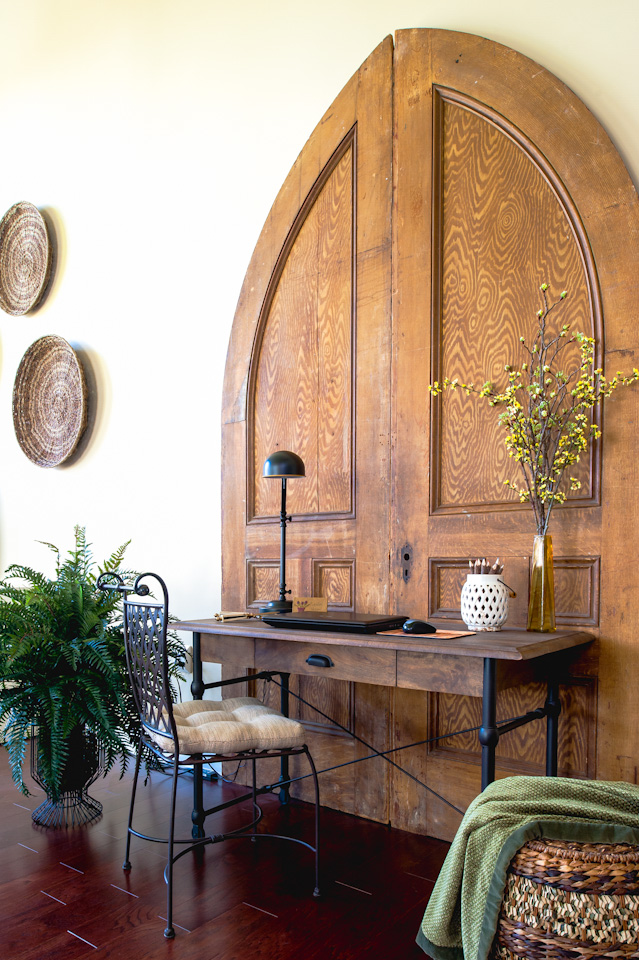 Salvaged doors  - A desk area was created in a large family room with 20 plus foot ceilings, by installing antique oversized doors.   Photo by   © Lisa Russman Photography | www.lisarussman.com