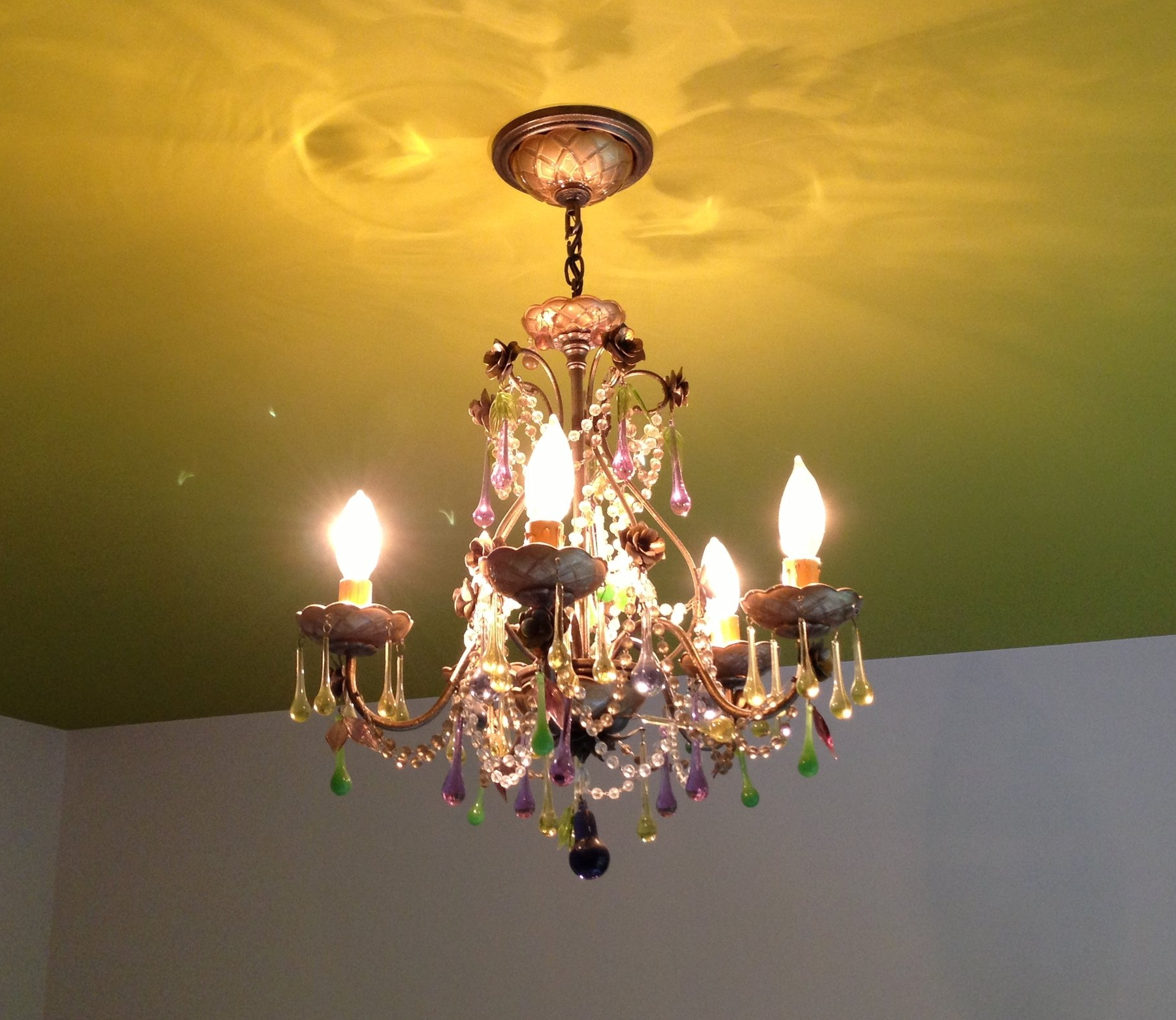 Painted chartreuse ceiling and mini chandelier from Schoenbeck
