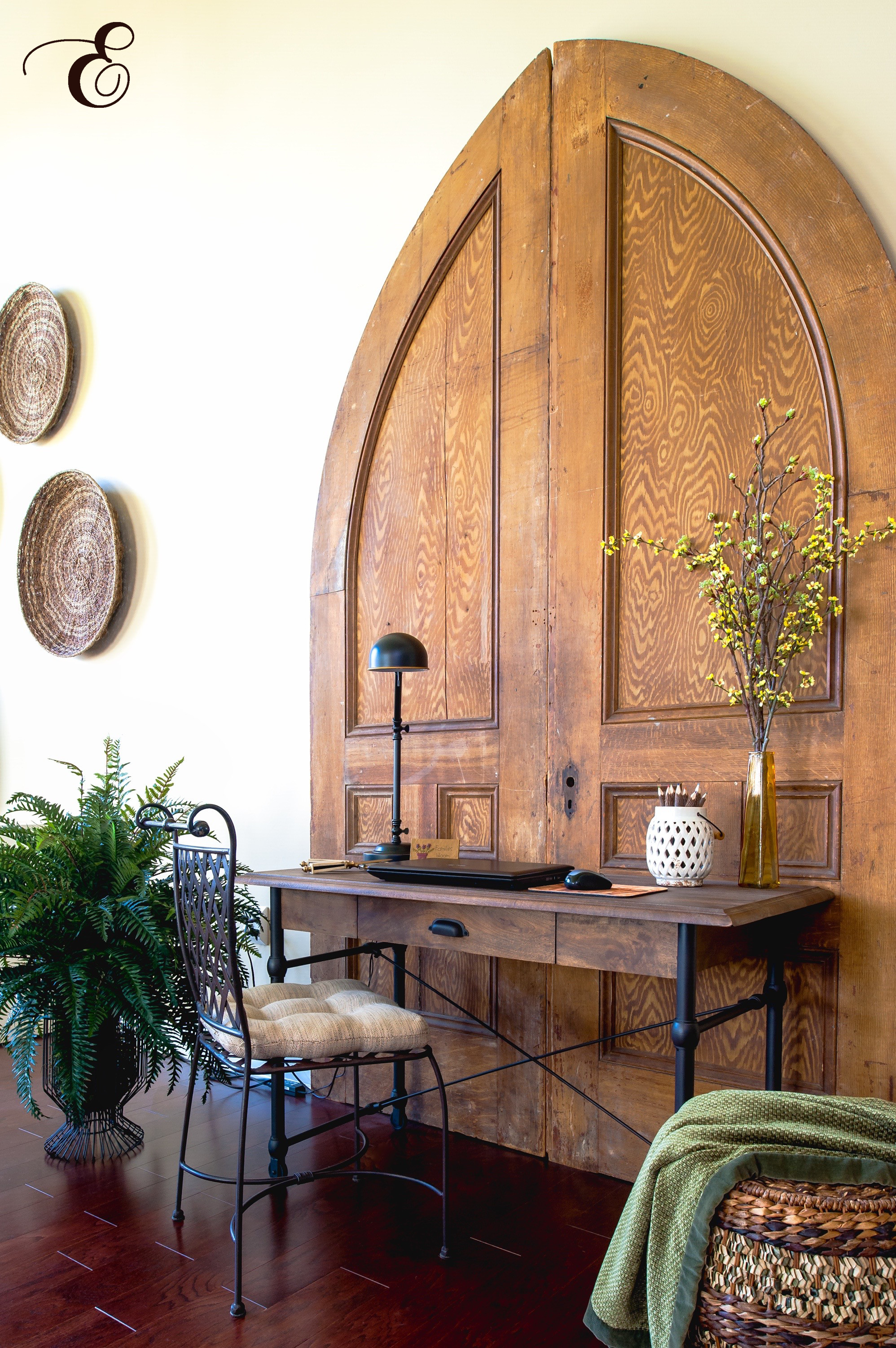 "We created a home office area in a large, open living room by installing antique church doors. Antiques are actually a ""green"" design element.  Photo   by  © Lisa Russman Photography 