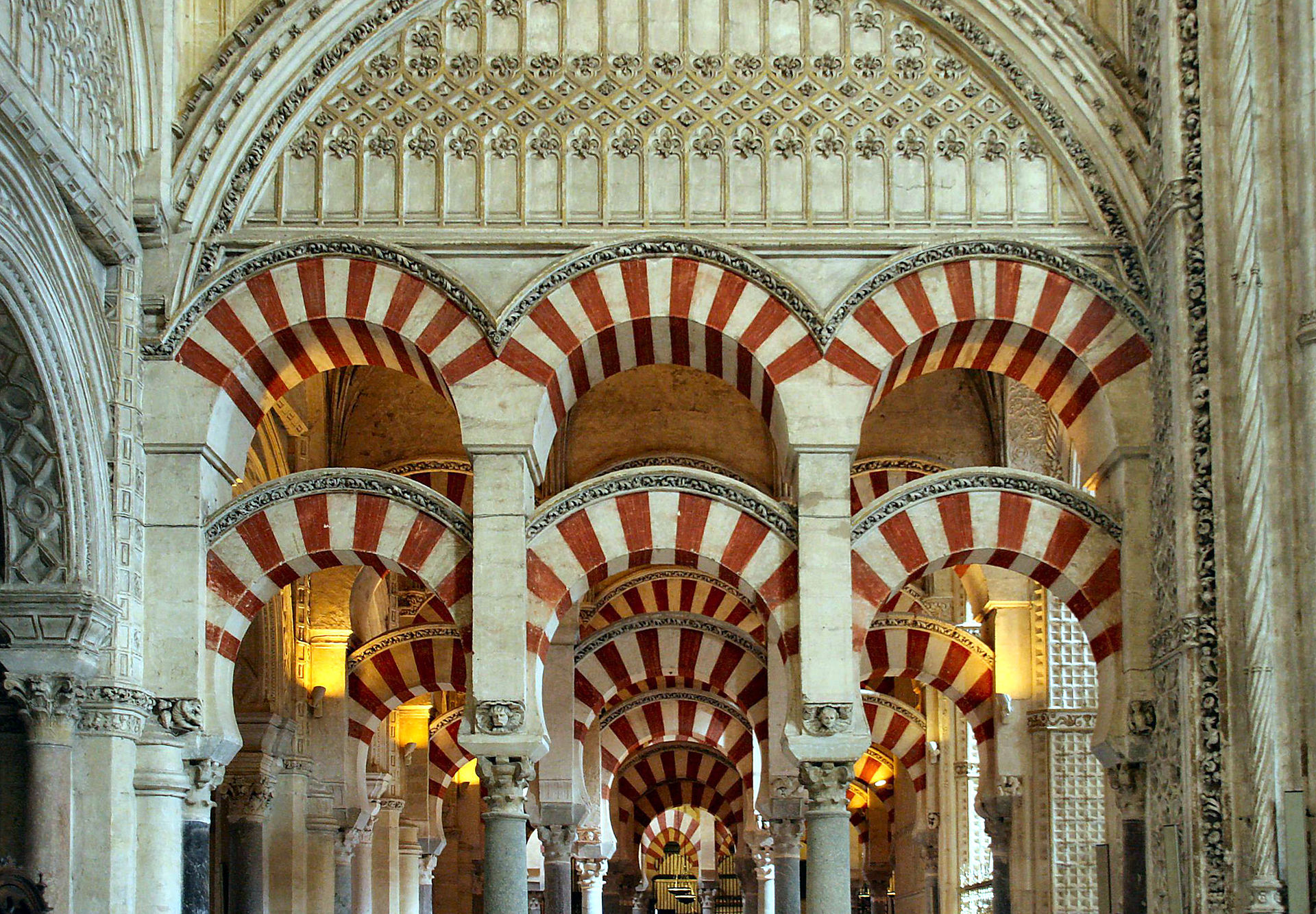 Texture, color, pattern and lighting are key elements in the design of the Mosque of Cordoba. The stripes were made using two different materials and the overlapping arches create new geometric forms. -Image from  Wikipedia .