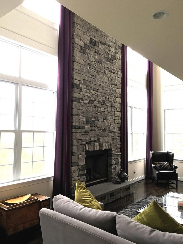 We created these custom window treatments for our client's dramatic, yet enormous windows. They definitely couldn't get away with curtains in a standard size.