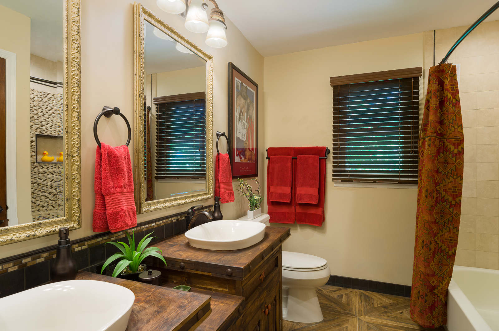 If you're not ready for full-on color try some red accents like we did in this rustic bathroom. By Ella Design Group.
