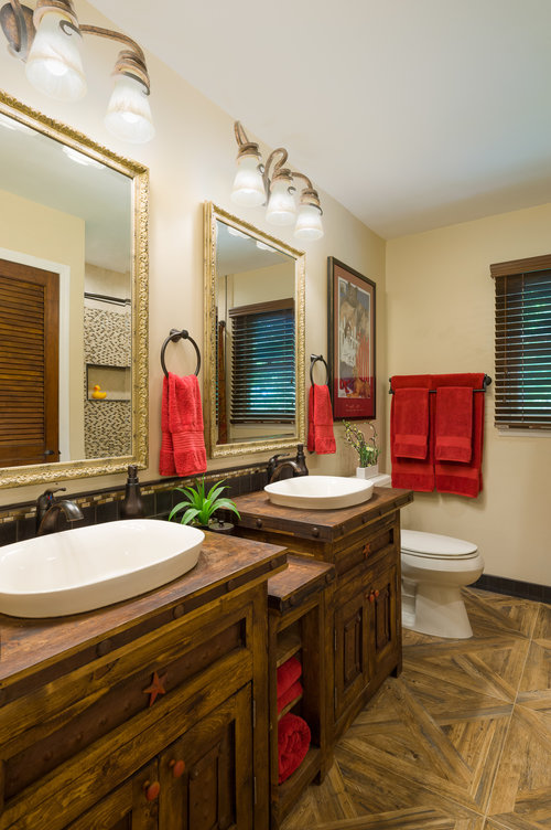 "A true example of practical also looking amazing. Those parquet ""wood"" floors in our client's guest bathroom are actually porcelain tile. Design by  Ella Design Group . Photo by  Paul S. Bartholomew ."