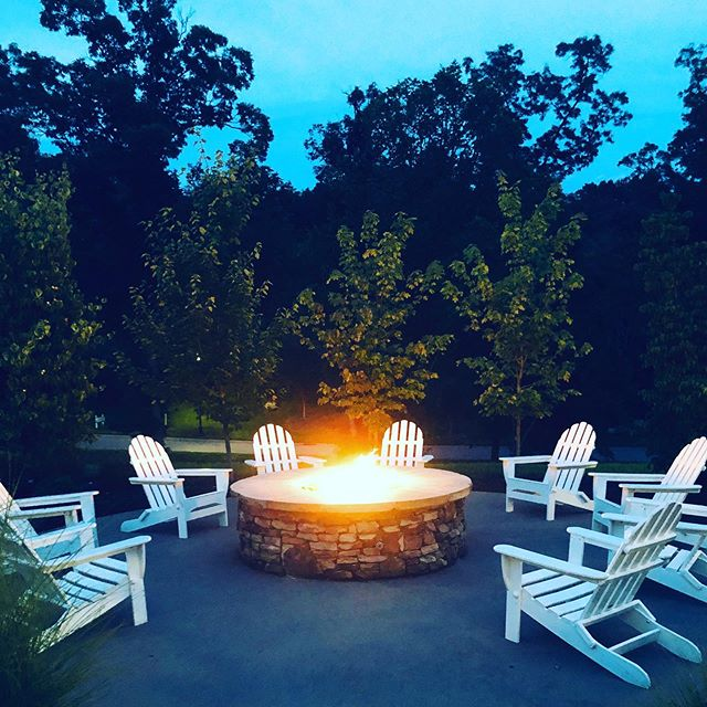Perfect for a cool summer evening in the Smoky Mountains. Simple white Adirondack chairs in repetition draw you into the natural beauty surrounding you and provide calm after a long day. #wholeheartdesign #wholeheartedathome #interiordesigner #authenticstyle #designinspiration