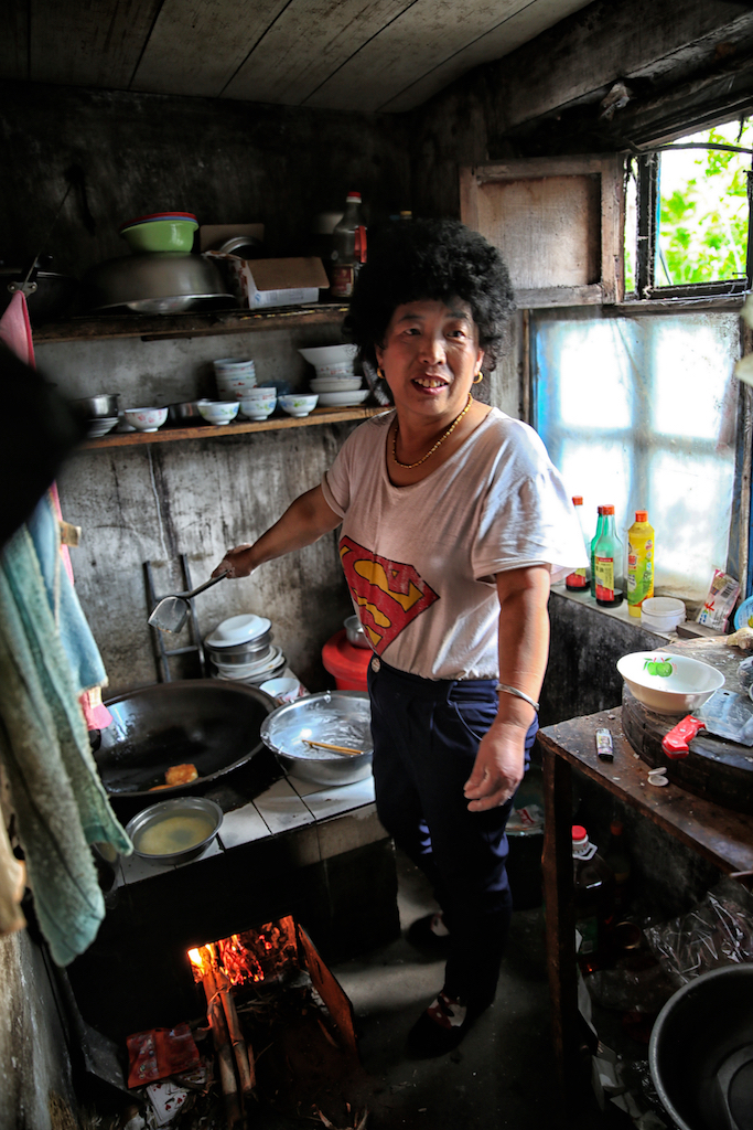 Mother prepares food in the kitchen.