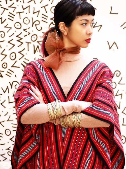 Hand-loomed Ifugao poncho ($90) and brass bracelet sets ($35) from VINTA Gallery