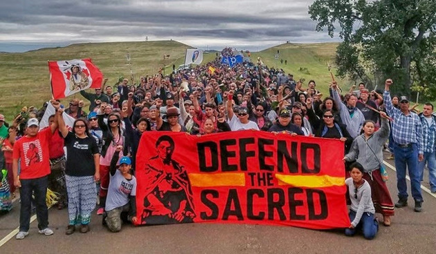 Members of the Standing Rock Sioux Tribe and supporters protest the Dakota Access Pipeline, 2016 / Photo source: Sacred Stone Camp Facebook page