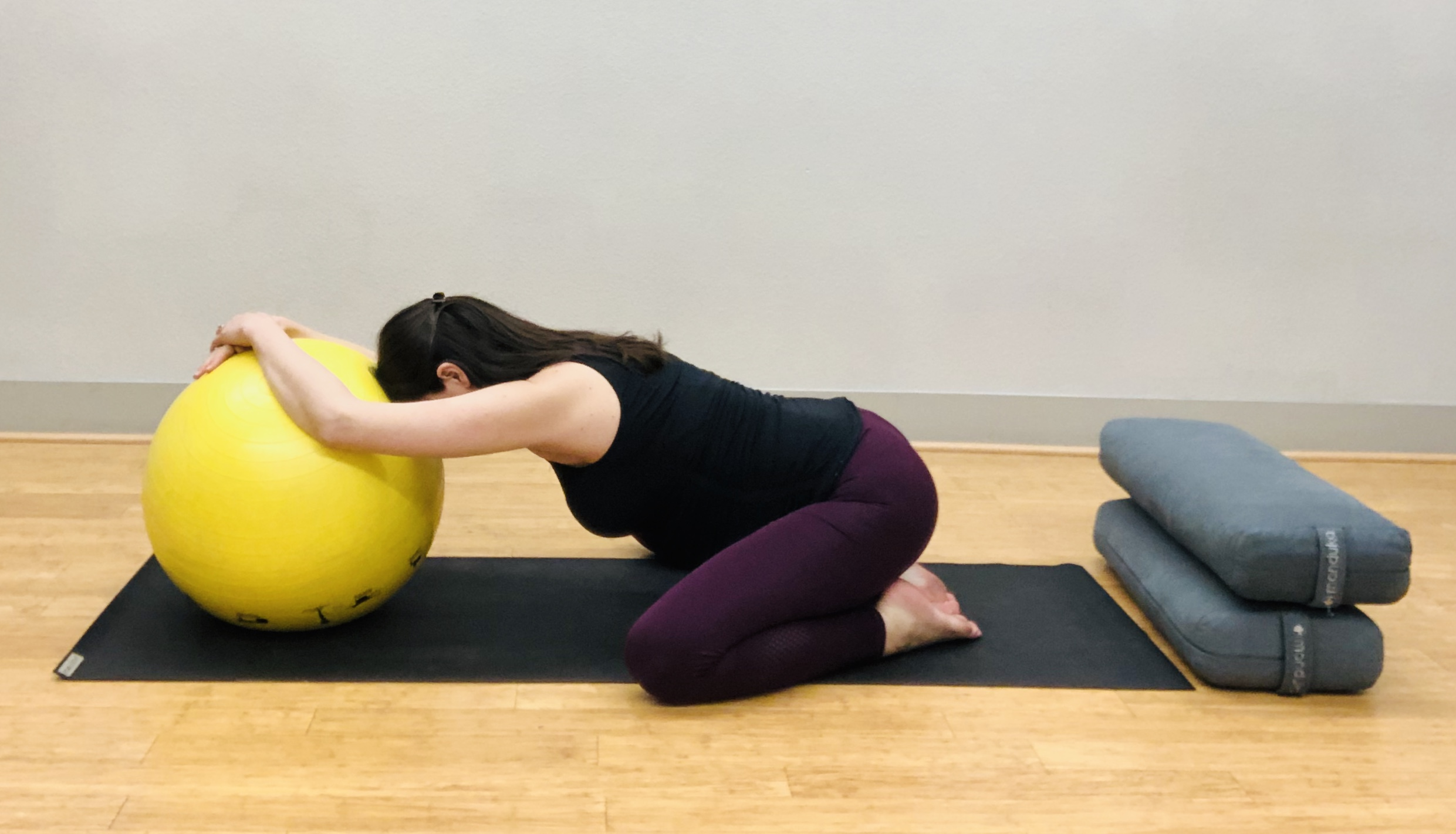 Option #2: Child's Pose with Birthing Ball. Allows for more space for belly and can feel good to rest forehead on the ball.
