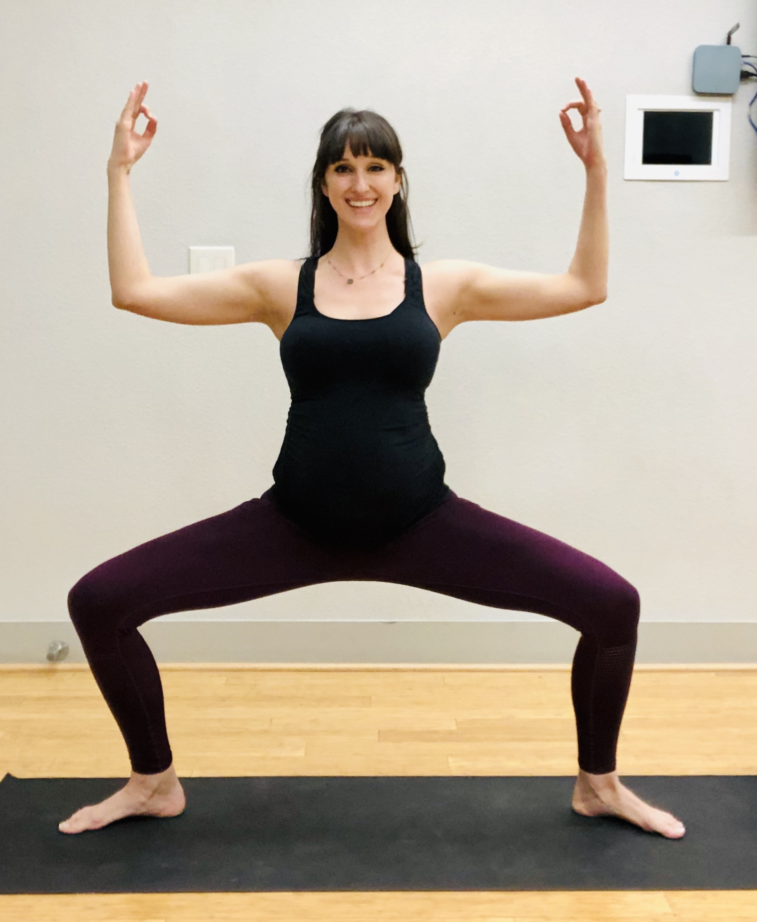 Goddess Pose. Heels in, toes out. Knees stacked over ankles.