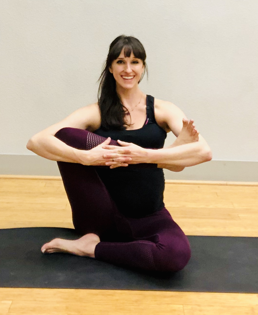 """Rock the Baby Warm-Up."" Stretch outer hips in prep for Cow Face Pose."