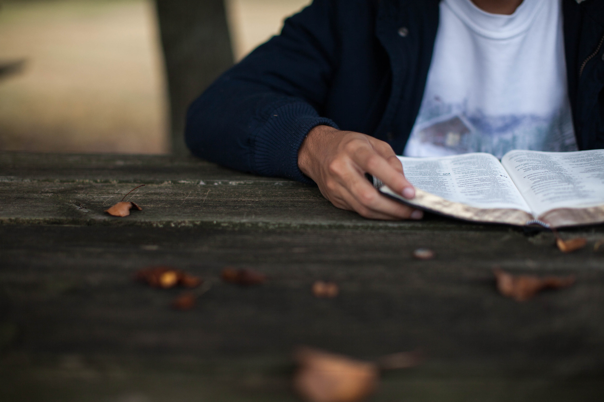 read_bible_at_wood_table.jpg