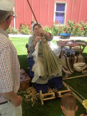Photo of one of last year's vendors creating hand made brooms while at the festival.