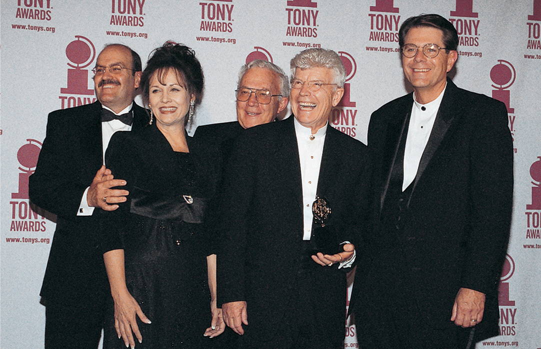 R. Scott Phillips (left), Sue Cox, Douglas N. Cook, Fred C. Adams, and Cameron Harvey receiving the 2000 Tony Award for Outstanding Regional Theatre. (Copyright Utah Shakespeare Festival.)