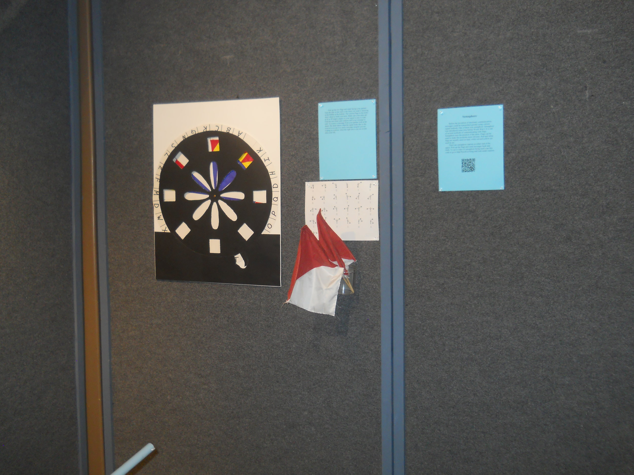 Semaphore - Turn the dial to learn how to send messages long distances using flags or your arms.