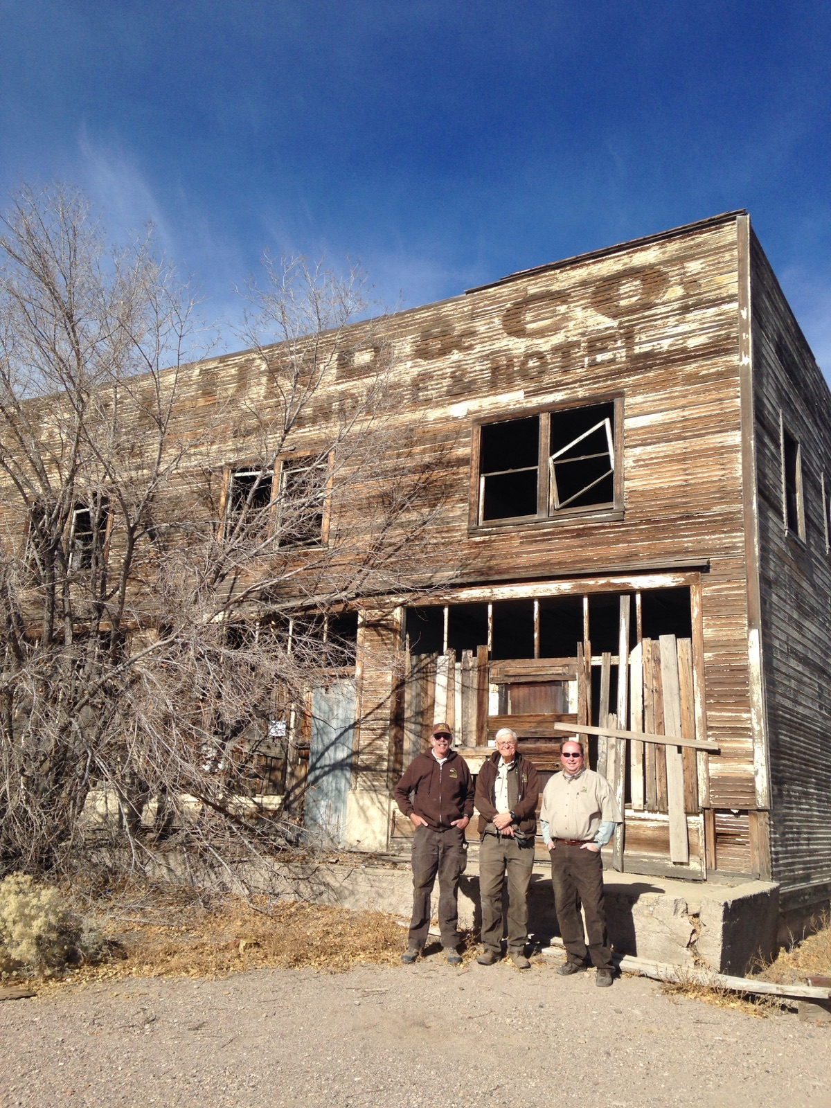 What remains of B.J. Lund's store with the museum team who picked up the carbide plant.