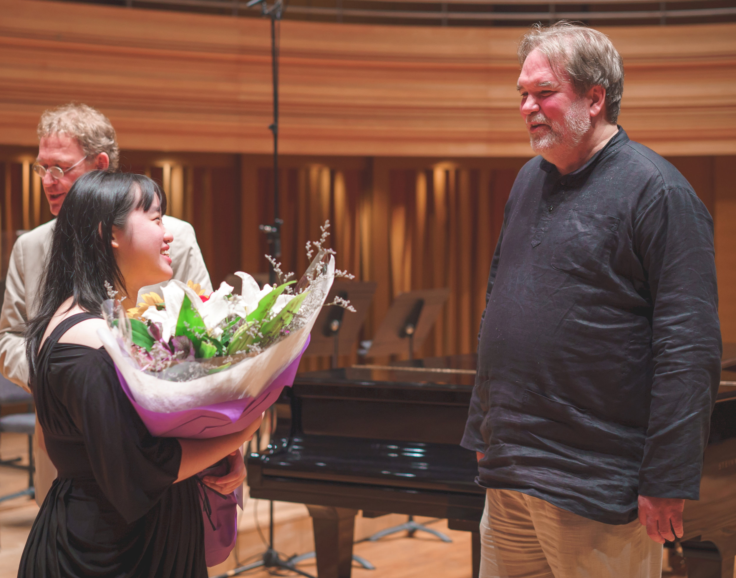 Above: Ho Qian Hui (left) after winning the Concerto Competition on 31 August, being congratulated by Professor Bernard Lanskey, Dean of the Conservatory