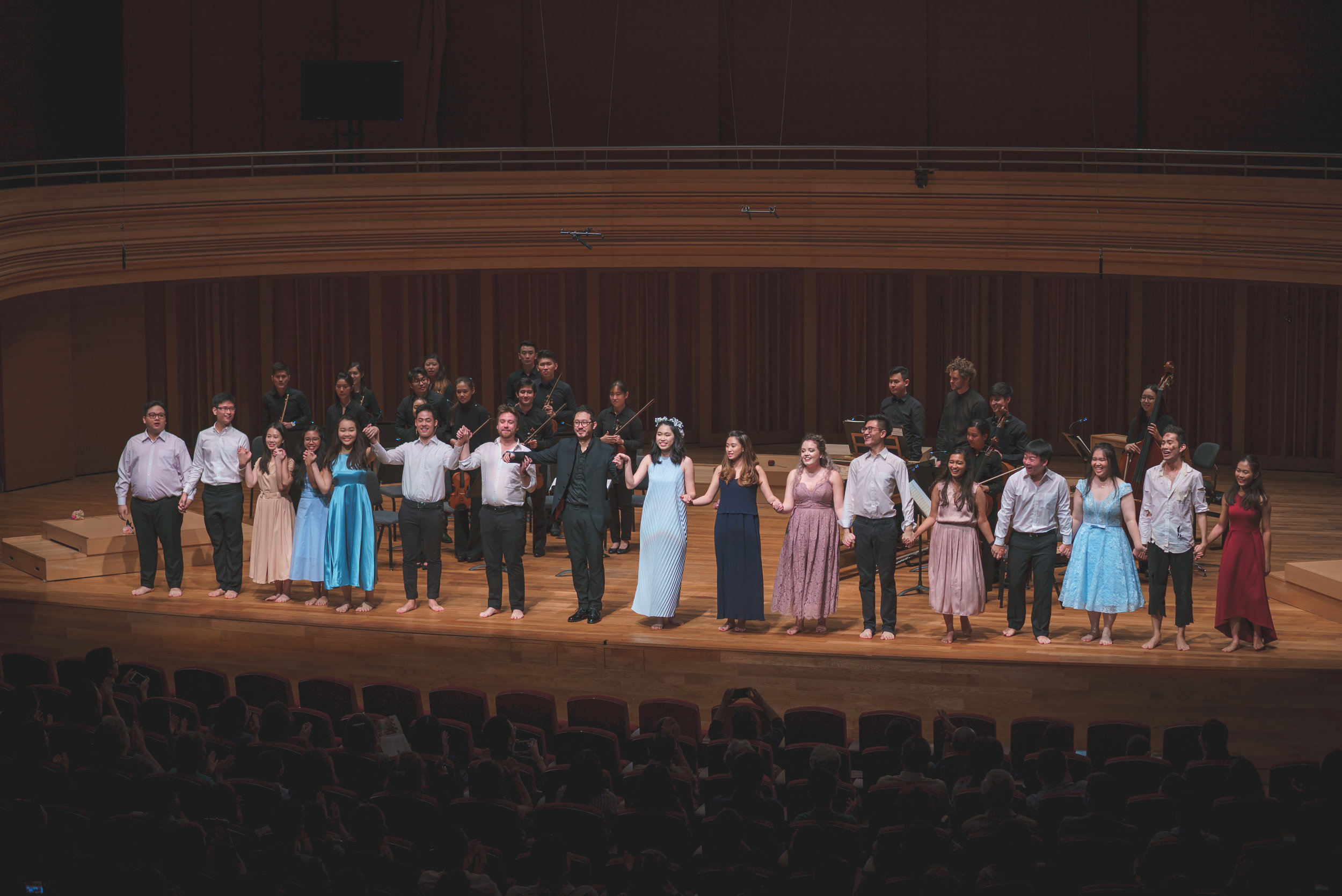 Above: Assoc Prof. Jason Lai (in black suit in the front row) taking a curtain call with the cast and orchestra