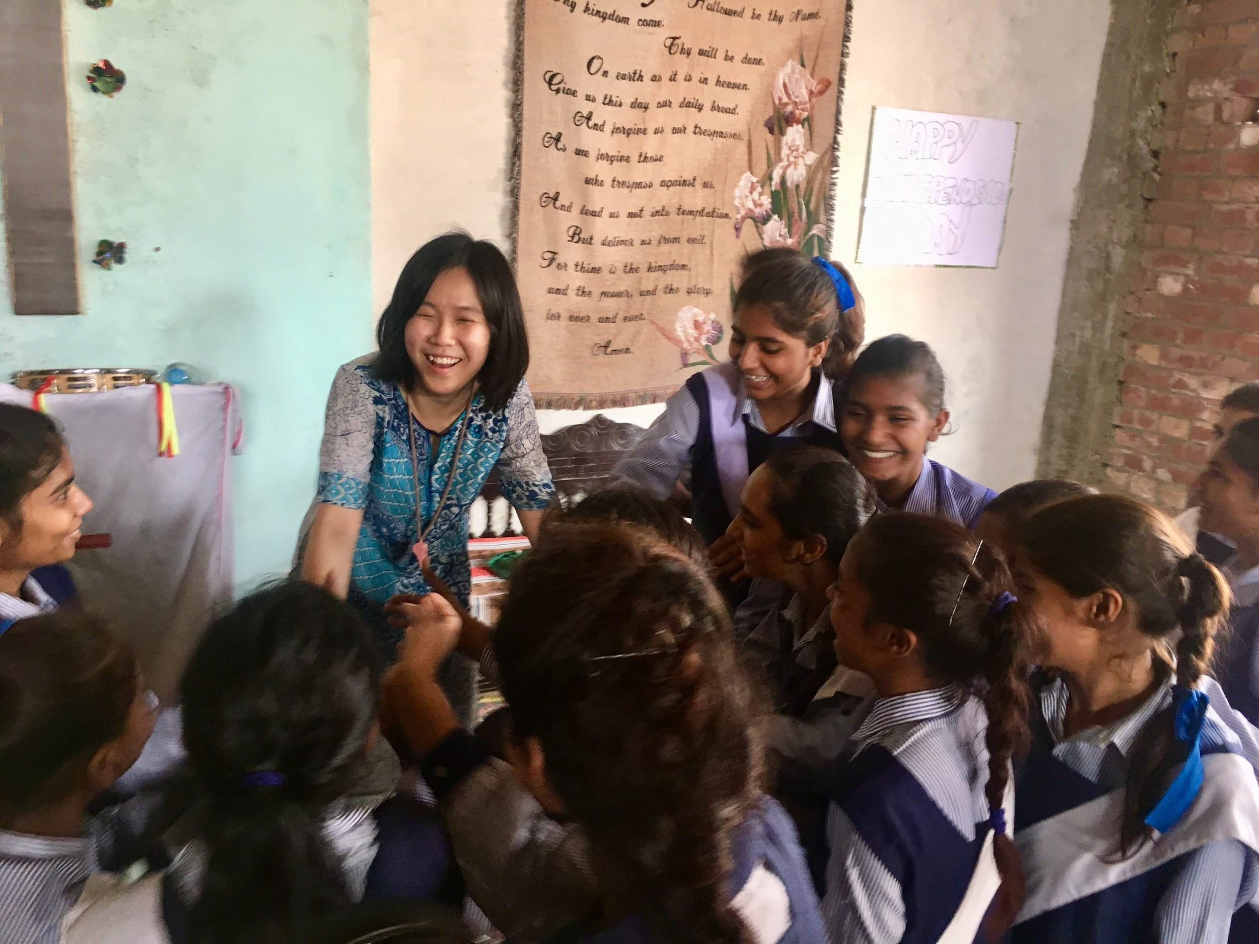 Above: Lee Wai Teng (BMus '16, Clarinet) with impoverished students in Pakistan