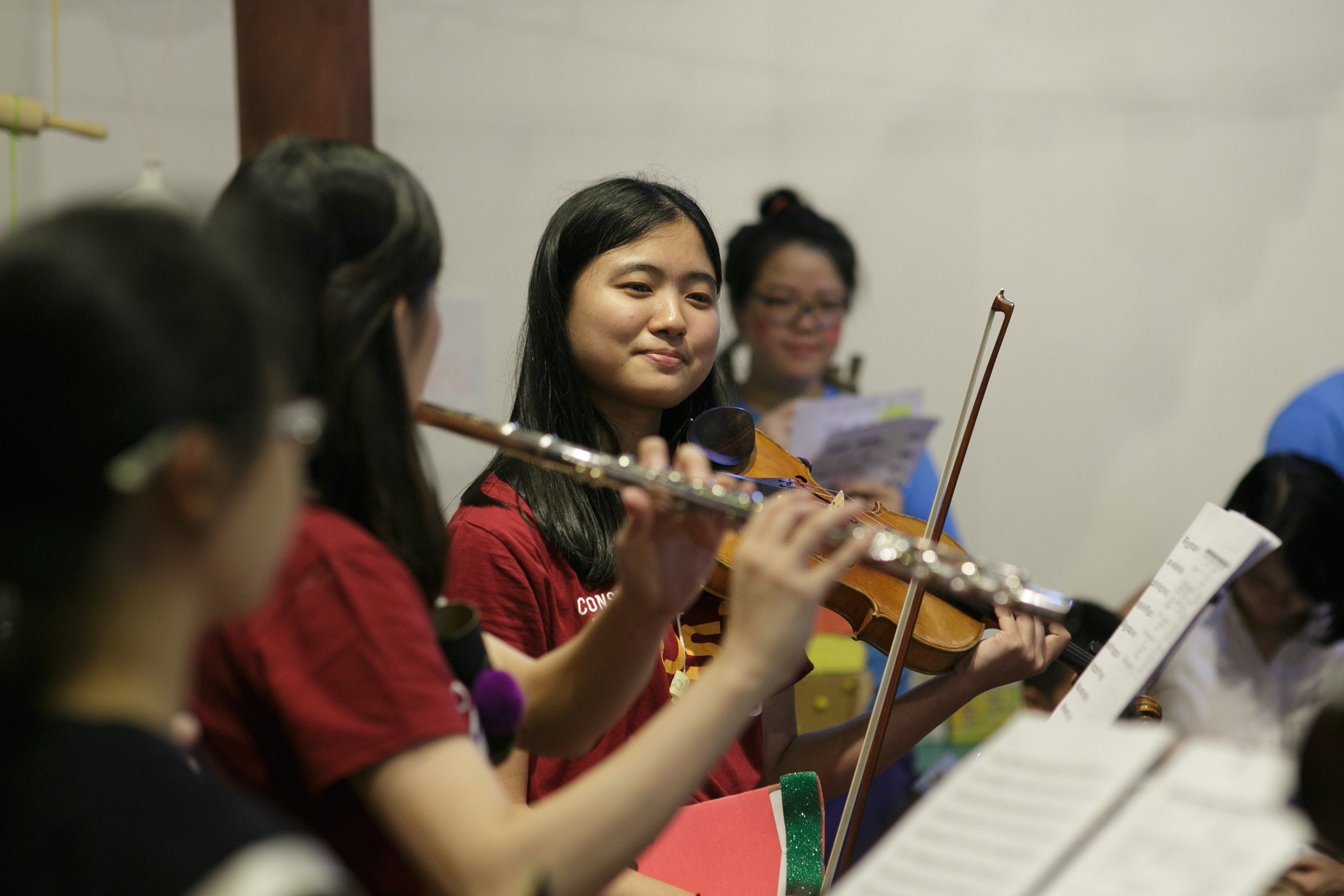Above: Natalie Koh (centre) with fourth year flautist Rachel Ho (left) and second year composition major Joey Tan (far left)