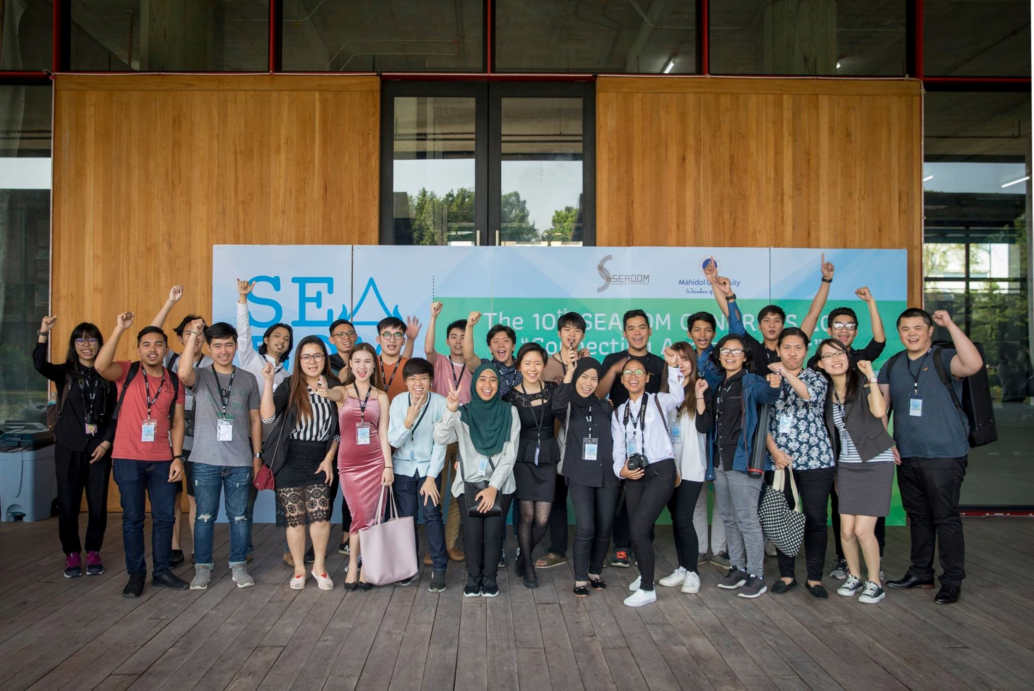 Above: YST students with delegates from the SEADOM conference