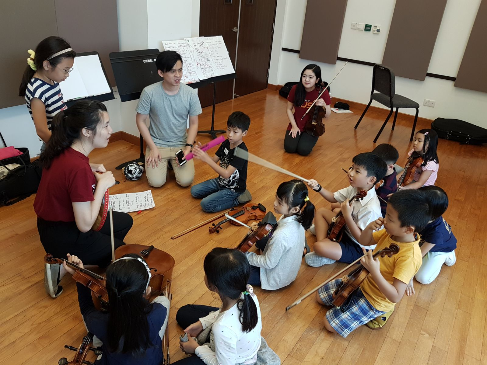 Rachel with young participants in the Kids' Philharmonic Creative Workshop