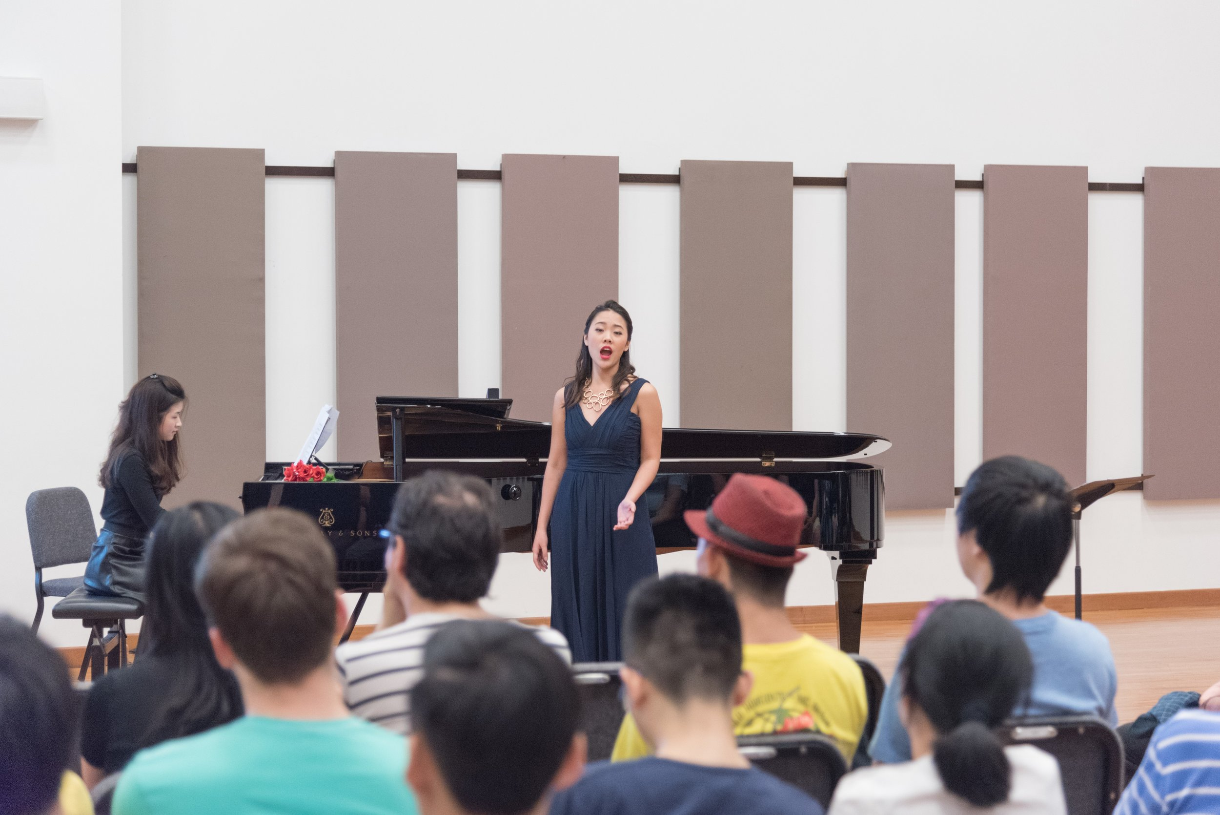 Rachel performing a lecture-recital at the YST Conservatory Orchestra Hall, accompanied by second-year pianist Adriana Chiew