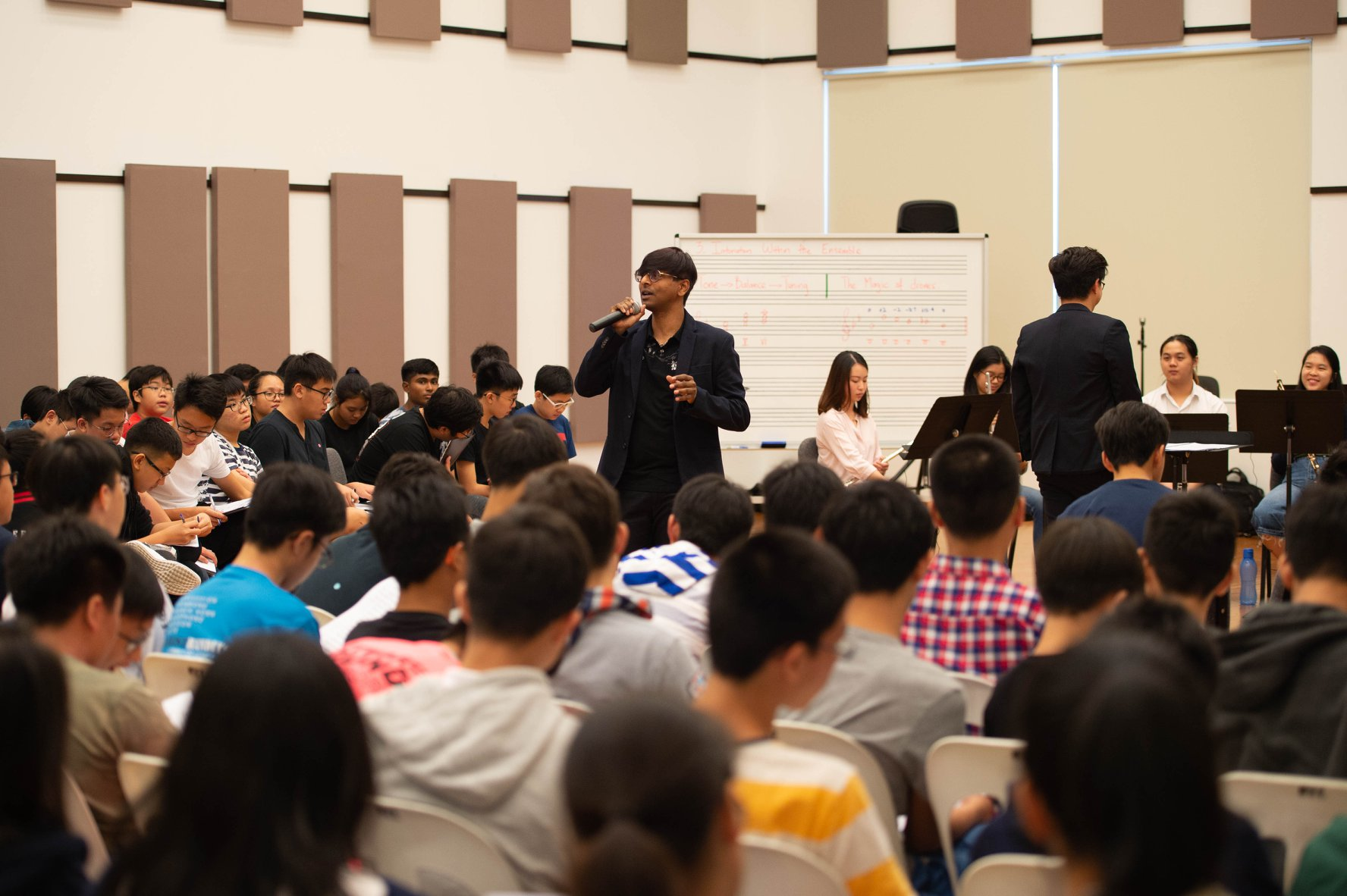 YST alumnus Alvin Seville ('18) presenting a workshop to over 200 band students at the Singapore Band Clinic.