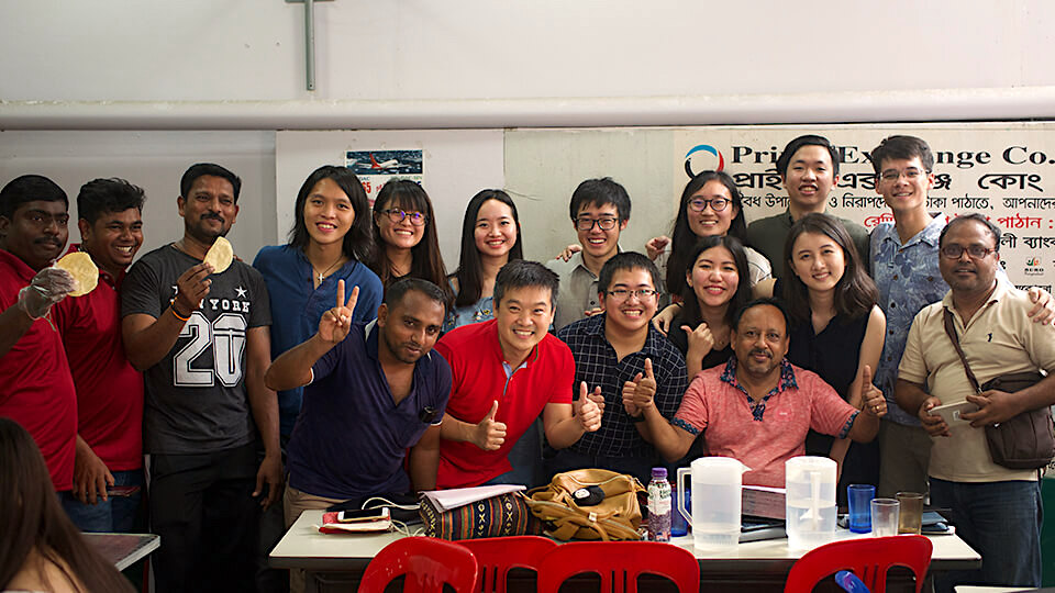 Neil (second row, fourth from left) at the project with migrant workers (Photo: Neil Chan)