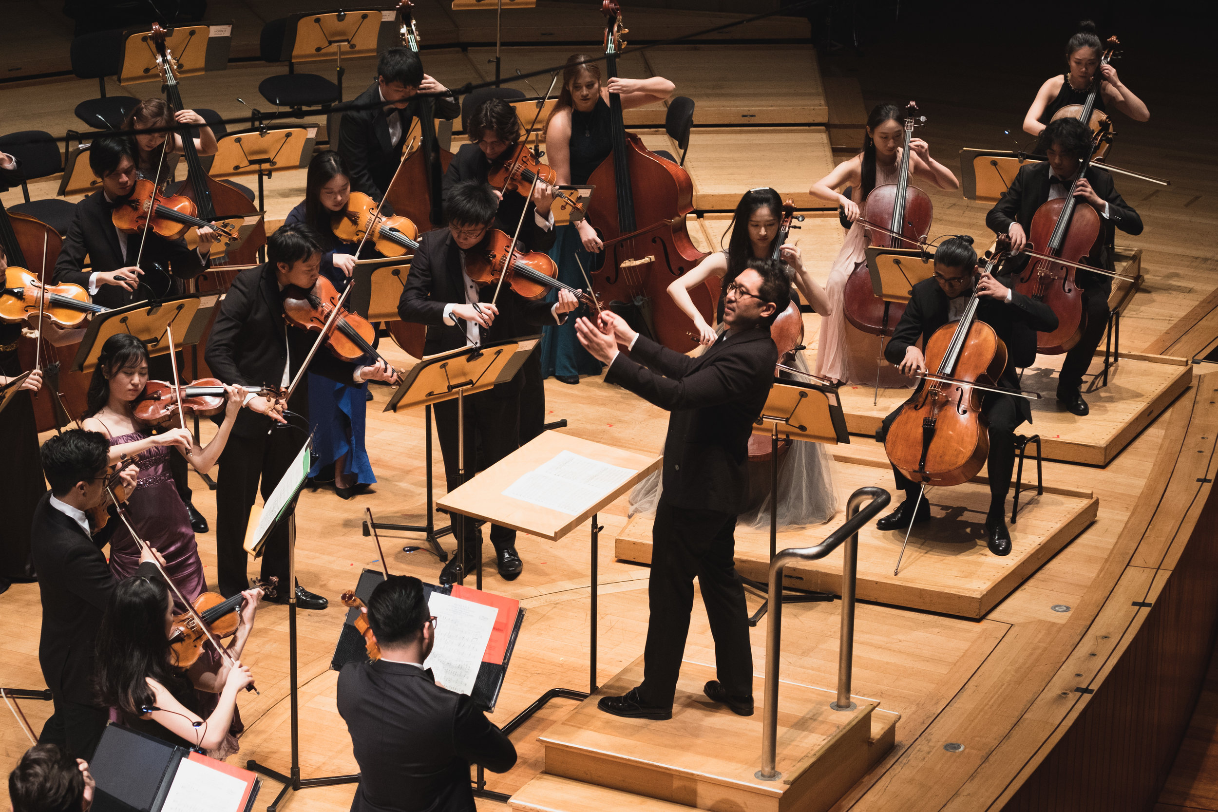The Conservatory Orchestra's string section in Vaughan Williams's  Fantasia on a Theme by Thomas Tallis  with Principal Conductor Jason Lai (centre), at the Esplanade Concert Hall.