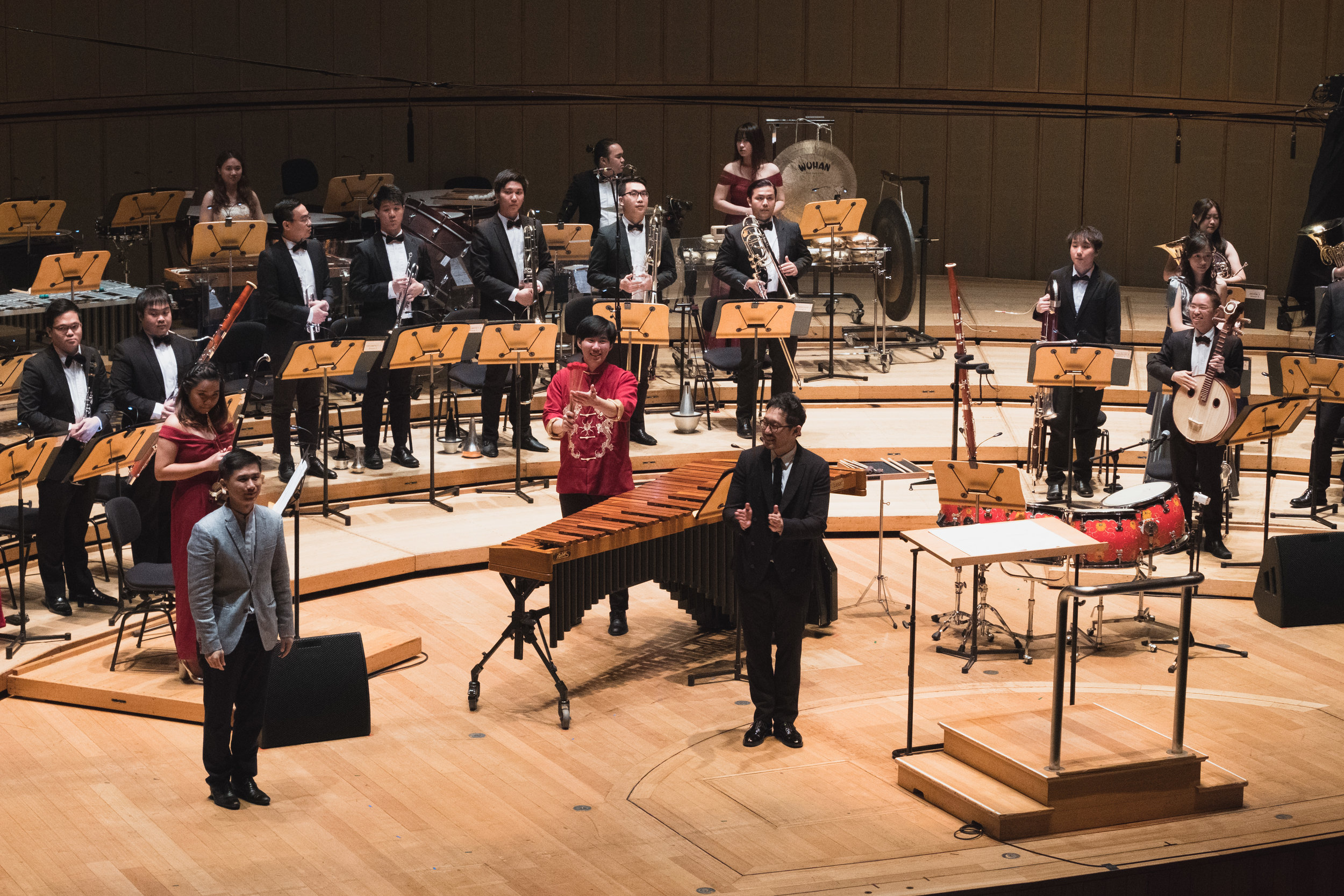 Asst Prof Chen Zhangyi being congratulated after the premiere of his Concerto for Erhu, Zhongruan, Percussion and Ensemble.