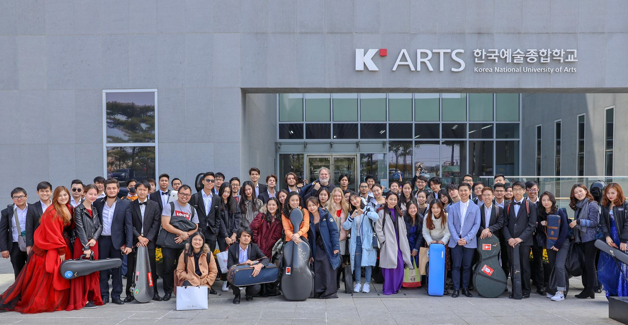 The YST Conservatory Orchestra in front of the Korea National University of Arts.