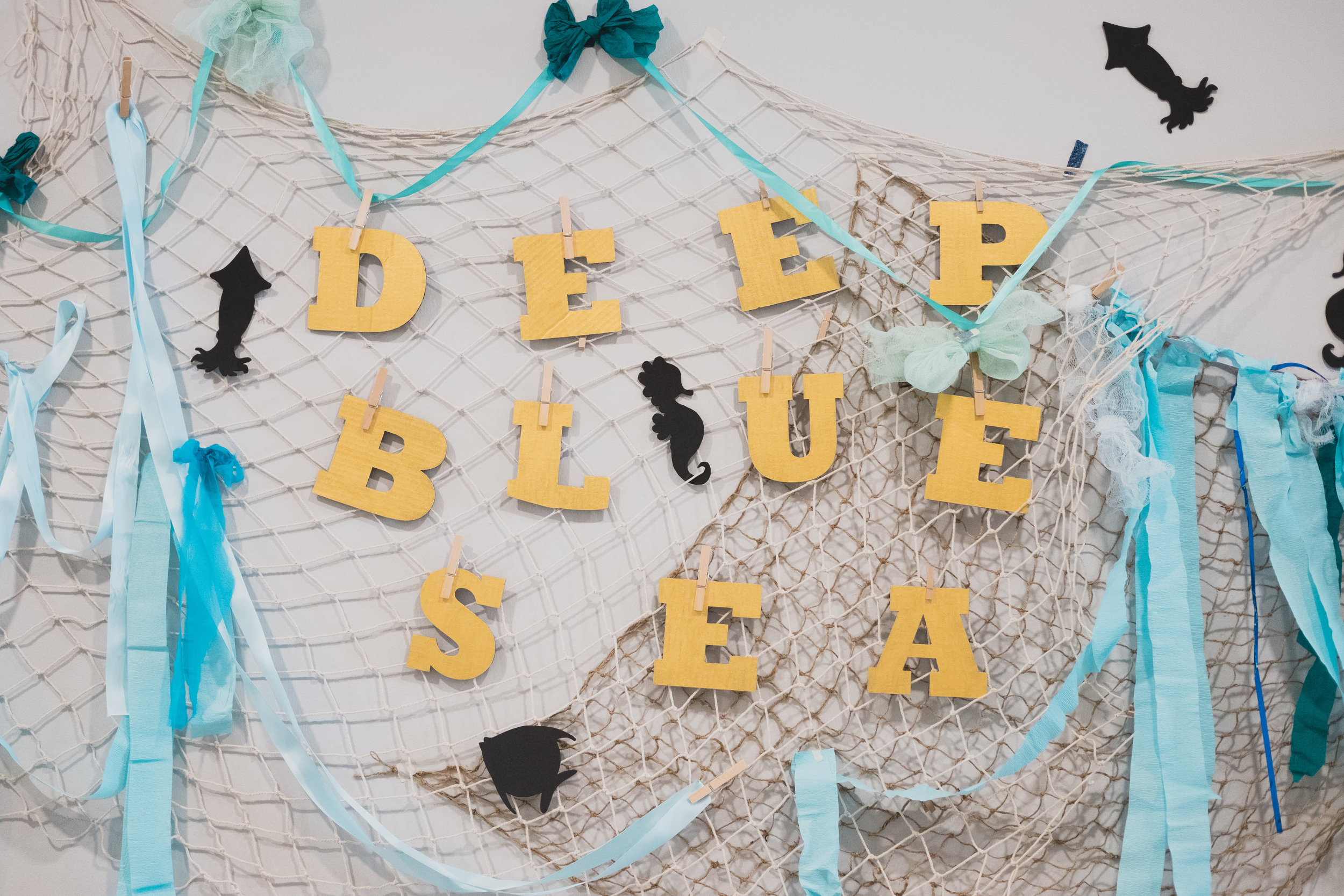 Backdrop and artwork for the Deep Blue Sea performance space.