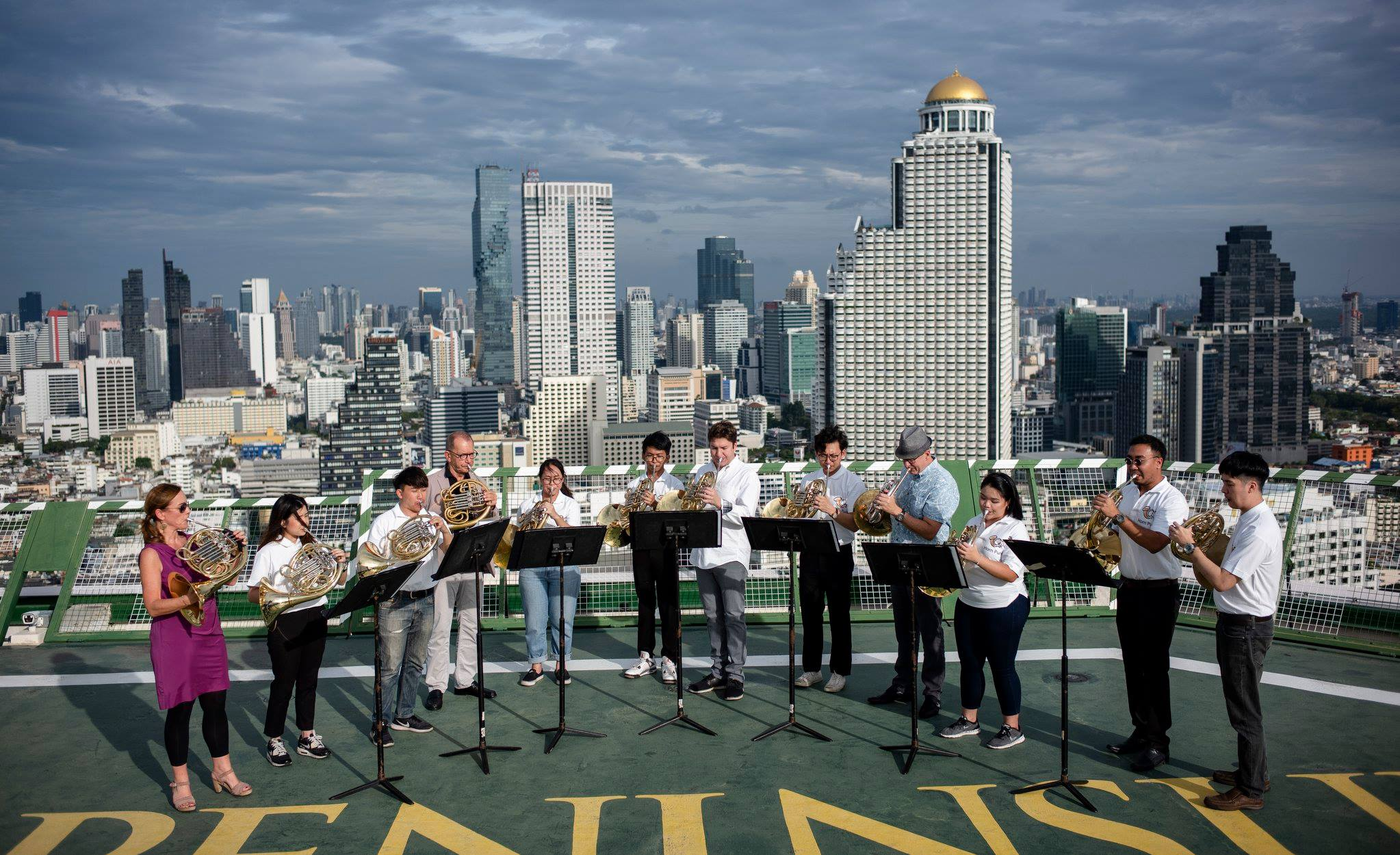 Mindy (third from right) playing with Horn Pure (Thailand) and the Berlin Philharmonic Orchestra Horns, while in Thailand.