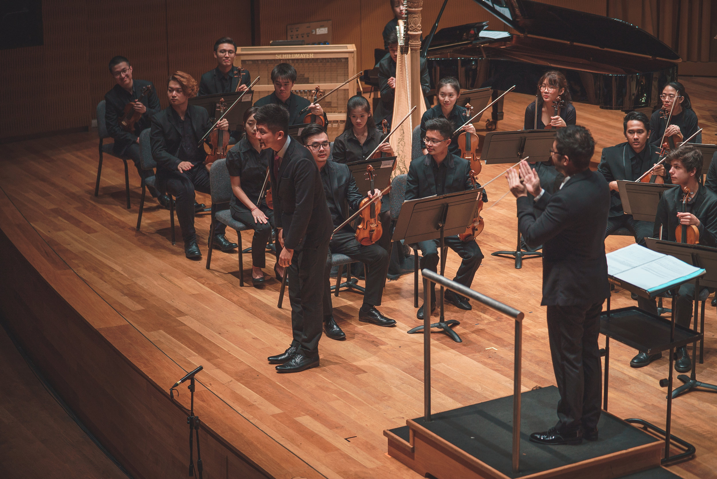 Jian Han taking a bow at the 2018 Conservatory Concerto Competition, where the Conservatory Orchestra premiered his work  Let me run 'til I fade away .