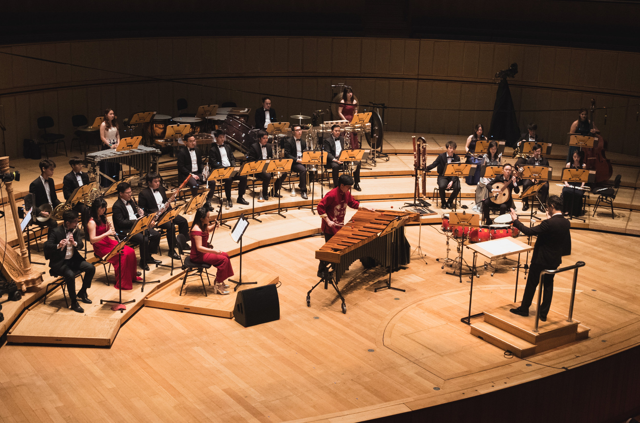 As part of the Conservatory Orchestra's Korea tour, Sulwyn (on right, holding zhongruan) was one of three soloists premiering a work by Asst Prof Chen Zhangyi for Chinese instruments and ensemble.
