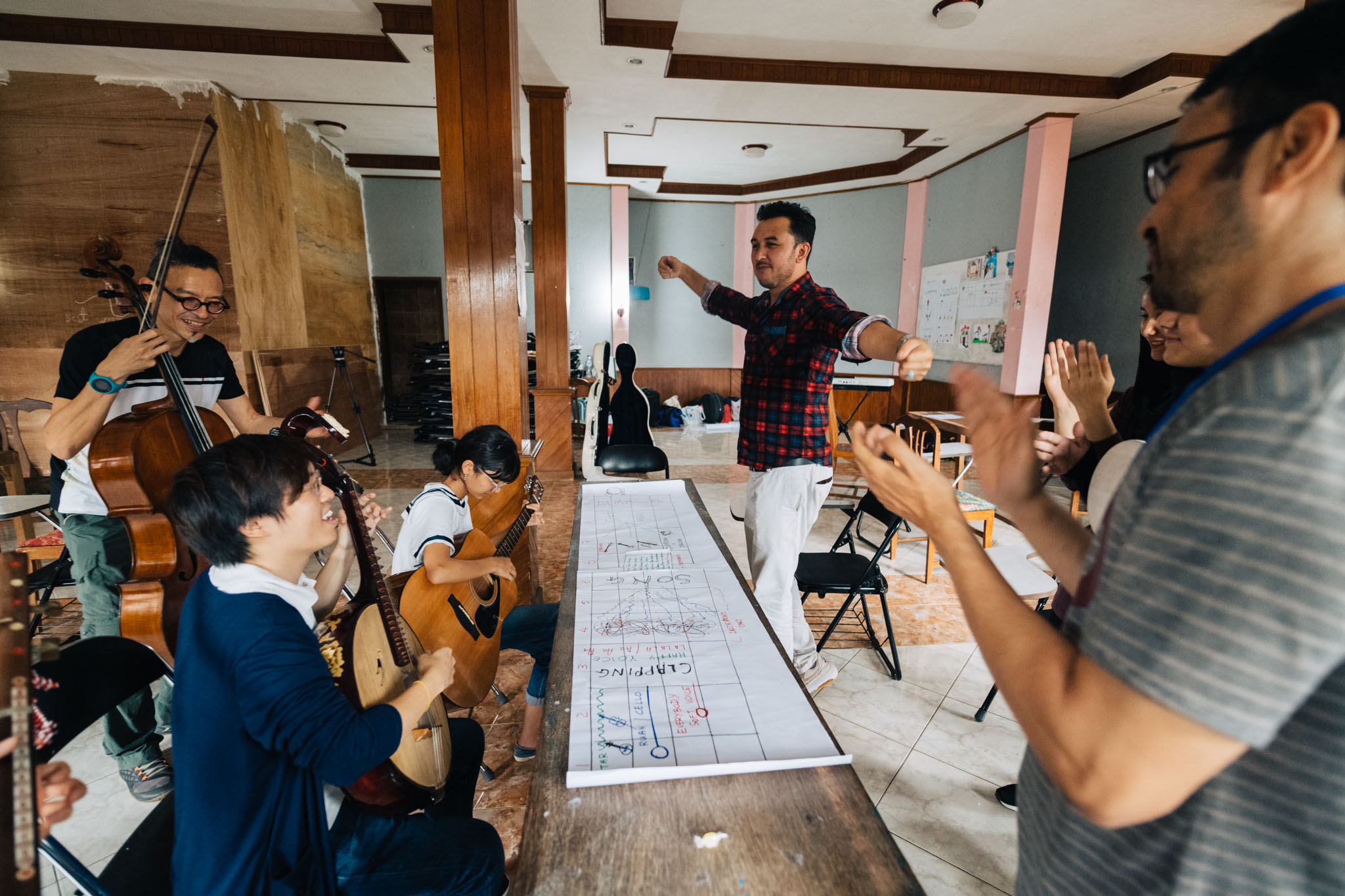 Working with the Singapore International Foundation and musicians from the Bandung Philharmonic, to empower Afghan refugees living in Indonesia to express themselves creatively through music (frontmost on left). Photo by Singapore International Foundation.