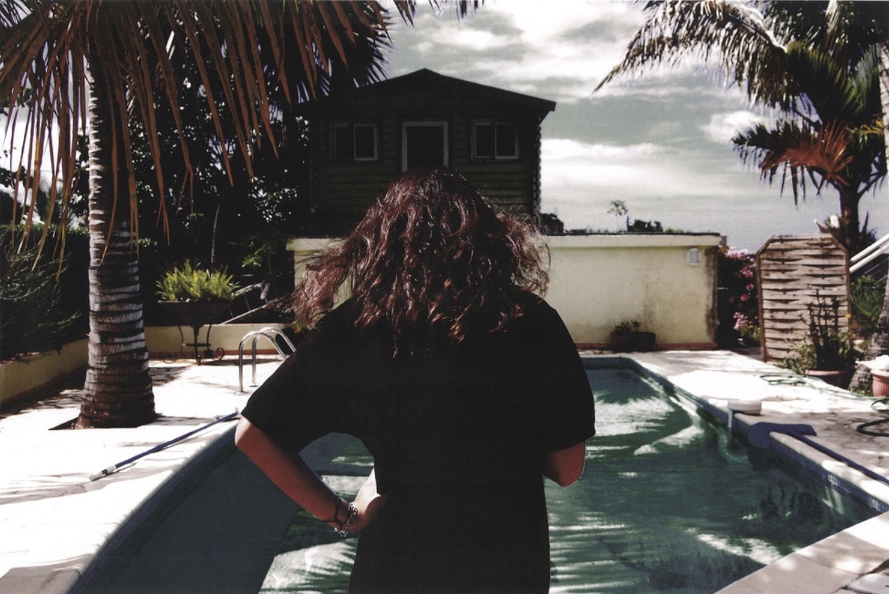 Krystie by the pool (from behind), 2010