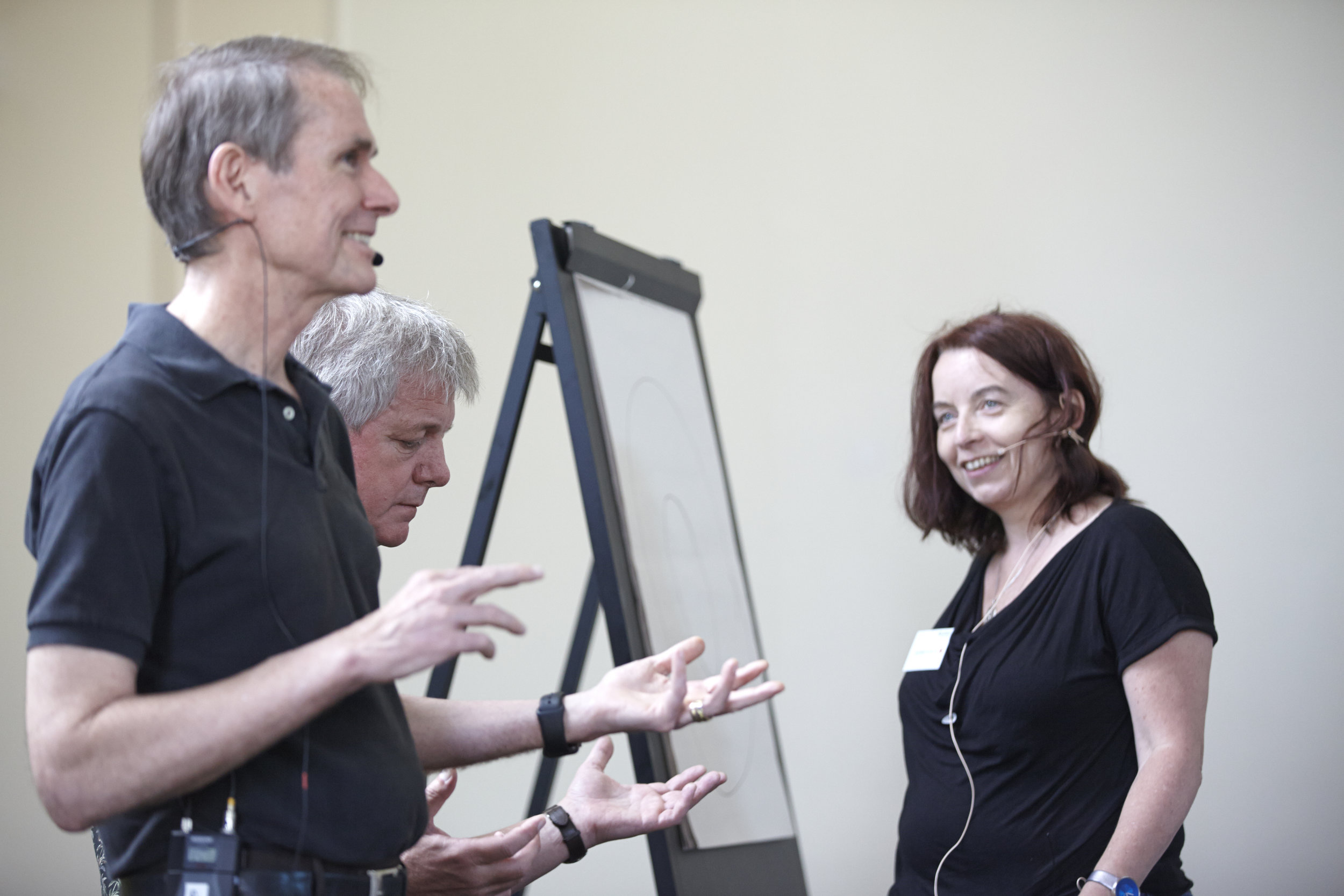 Client smiling with Steve and Robert mirroring.jpg