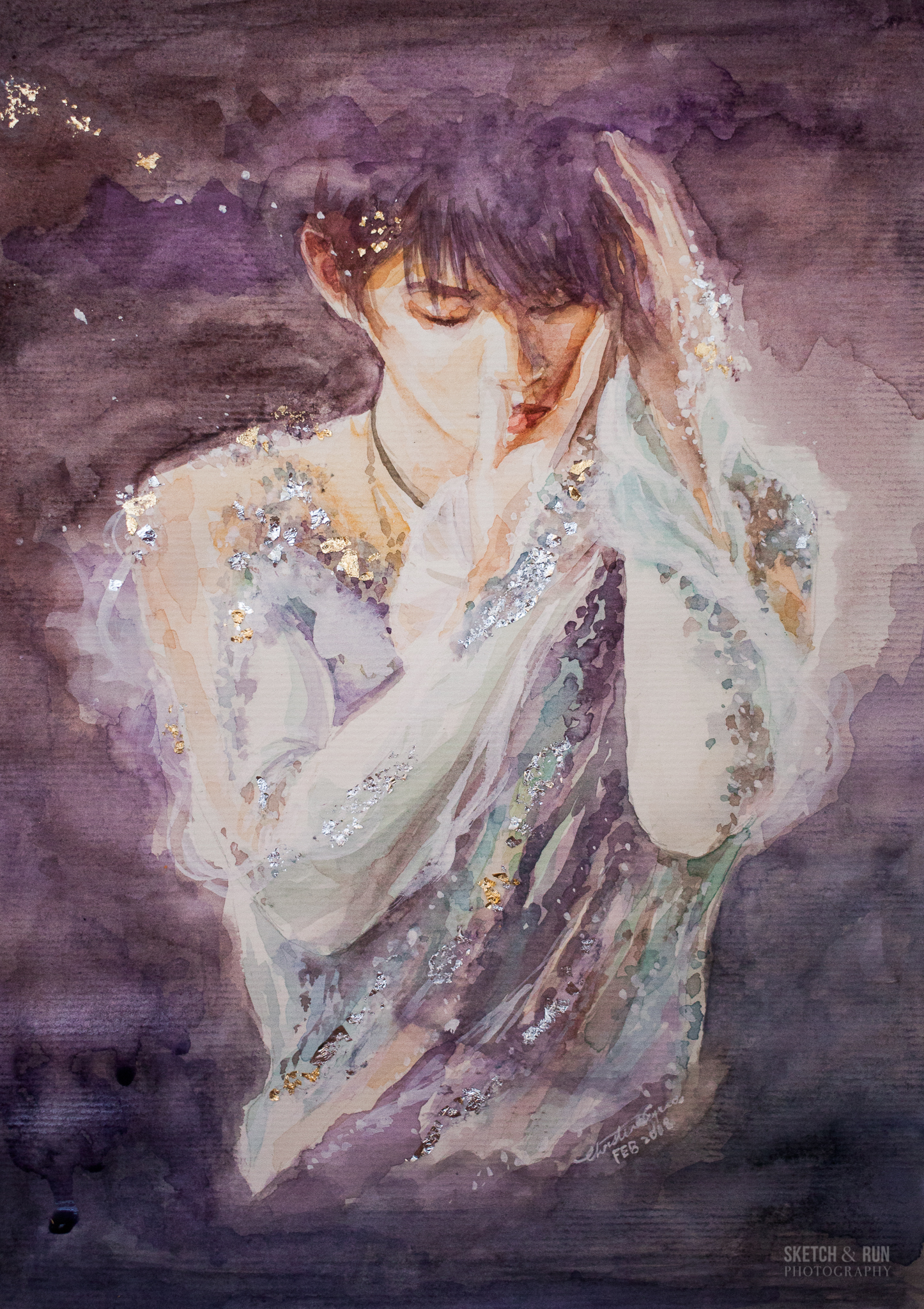 Yuzuru Hanyu , reigning mens singles Olympic Champion, World Champion and world record holder.Suffered injury during the NHK Trophy in November 2017 and will be making his comeback at the Olympics. Painting based on his 2016 World Championship exhibition performance,   Requiem of Heaven and Earth  , dedicated to the victims of the 2011 Japan Earthquake and Tsunami disaster -- Yuzuru was also a victim of the disaster himself. At the time of the skate in Boston, he was  hiding a lisfranc ligament injury and won silver.He said later that he skated the performance not knowing if he would be able to skate competitively again.