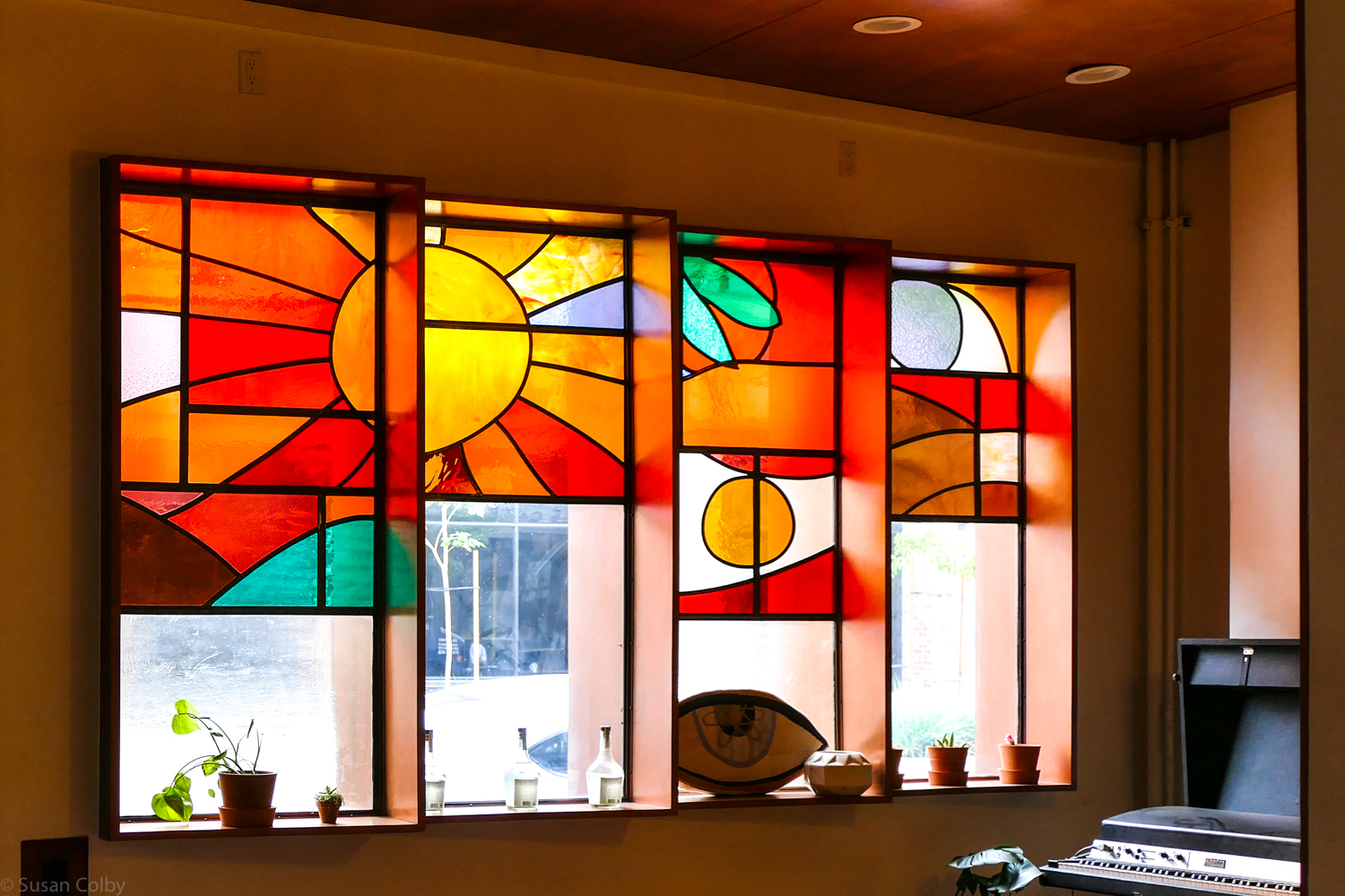 Stained glass depicting California sunshine and clementine by artist Megan Whitmarsh