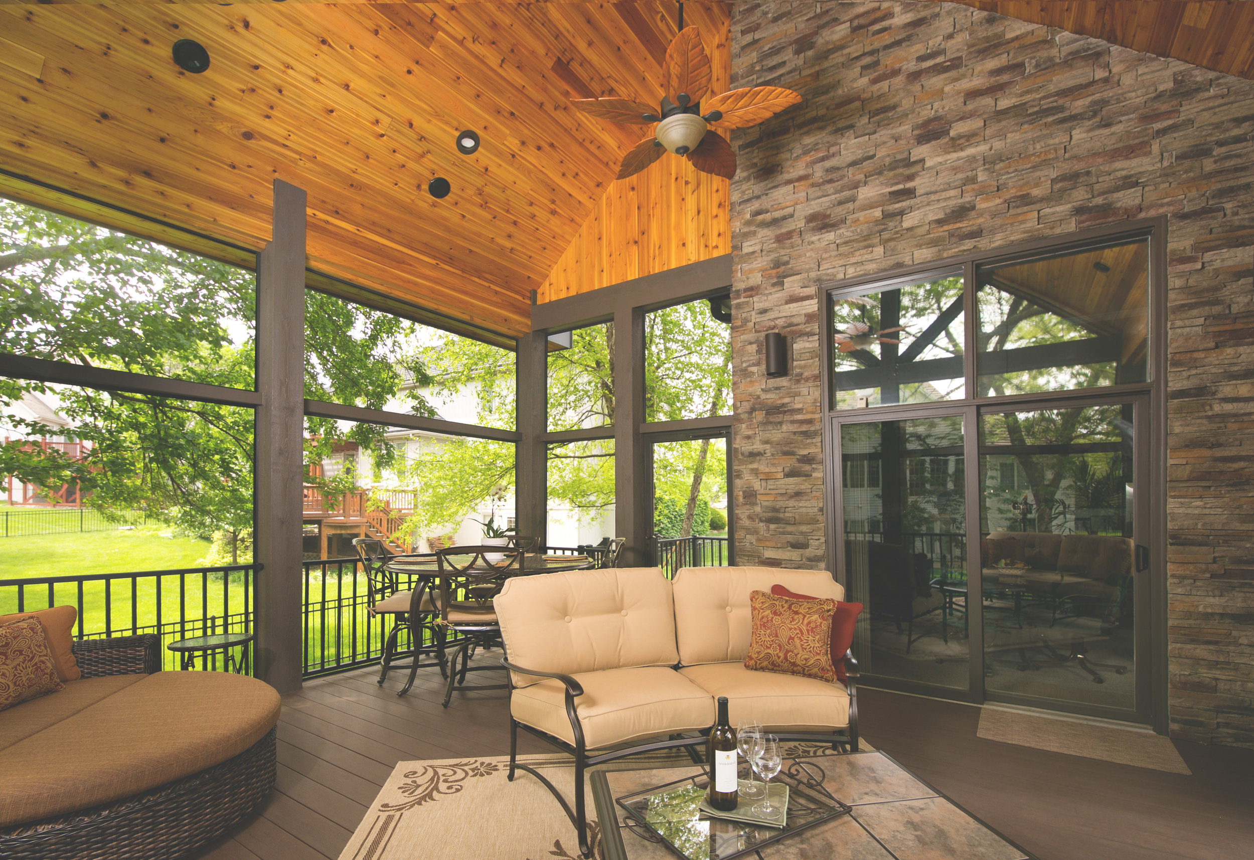 This custom porch features some of the best building materials including, AZEK decking, Screeneze, and Westbury Railing