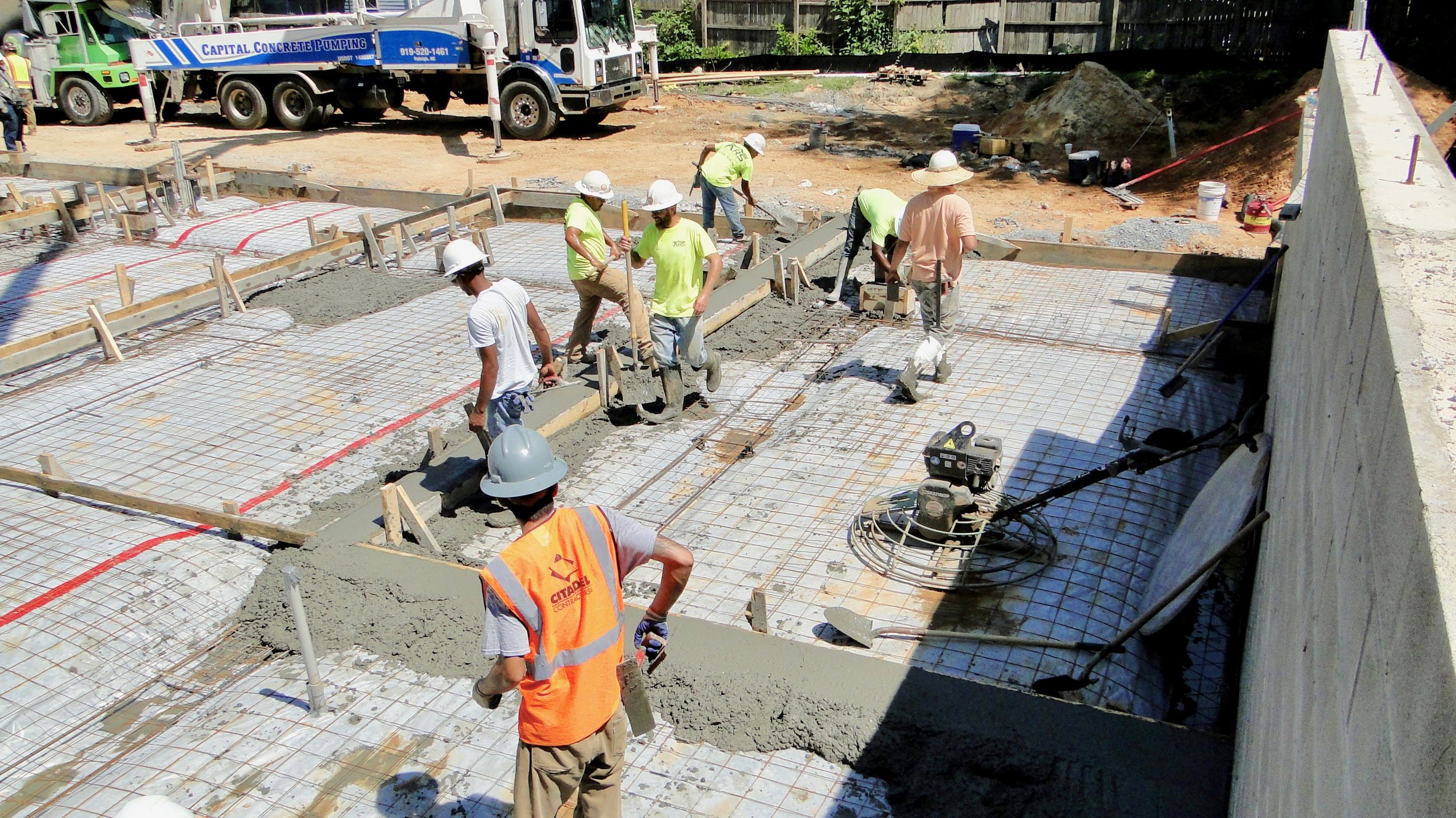 537 New Bern Ave #109 (Unit 10) - Wall base forms being filled and shaped indicate garage depth and width.