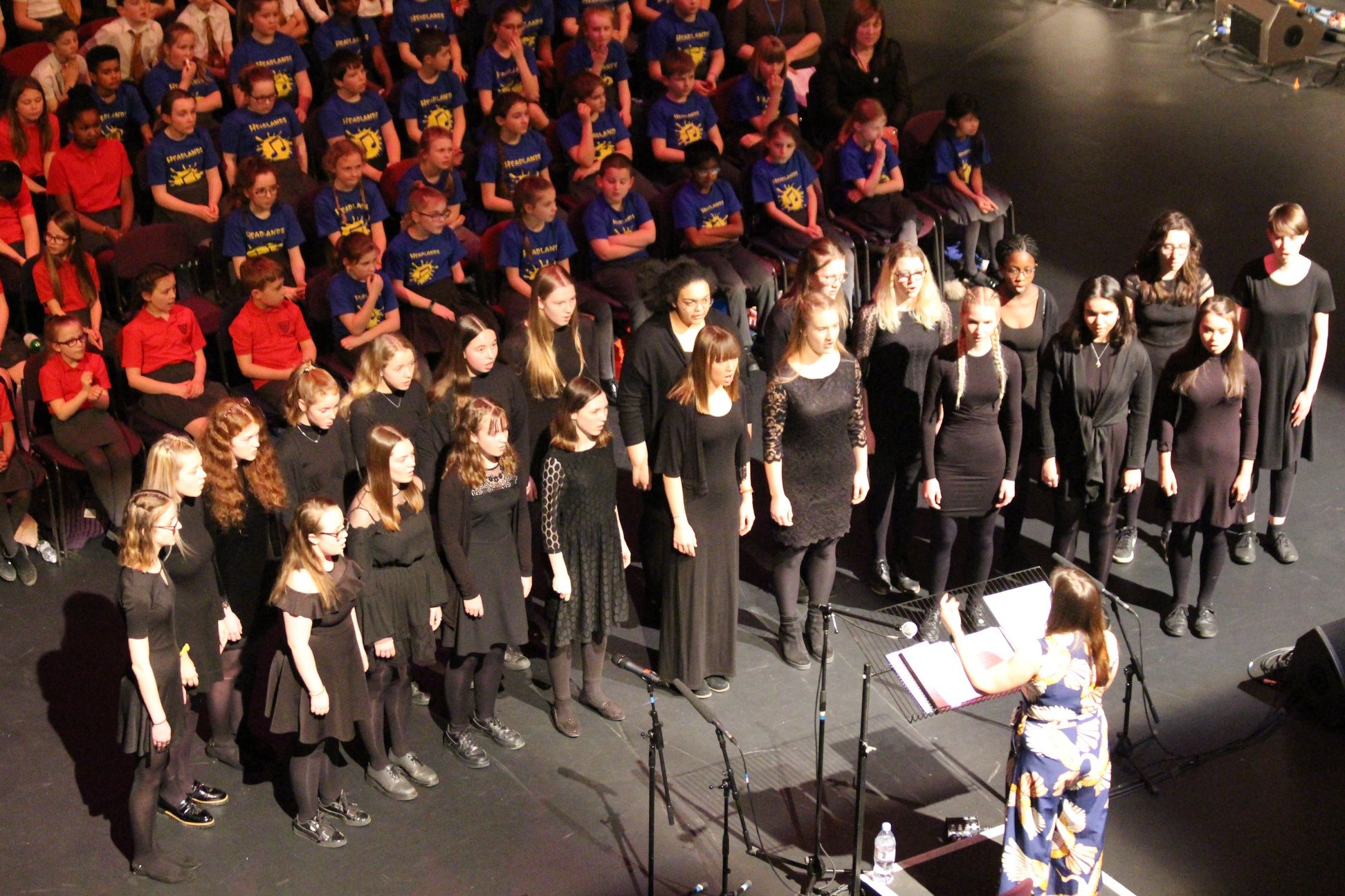 Jessica conducting the Northamptonshire County Senior Girls Choir at the Derngate Theatre, Northampton 2019